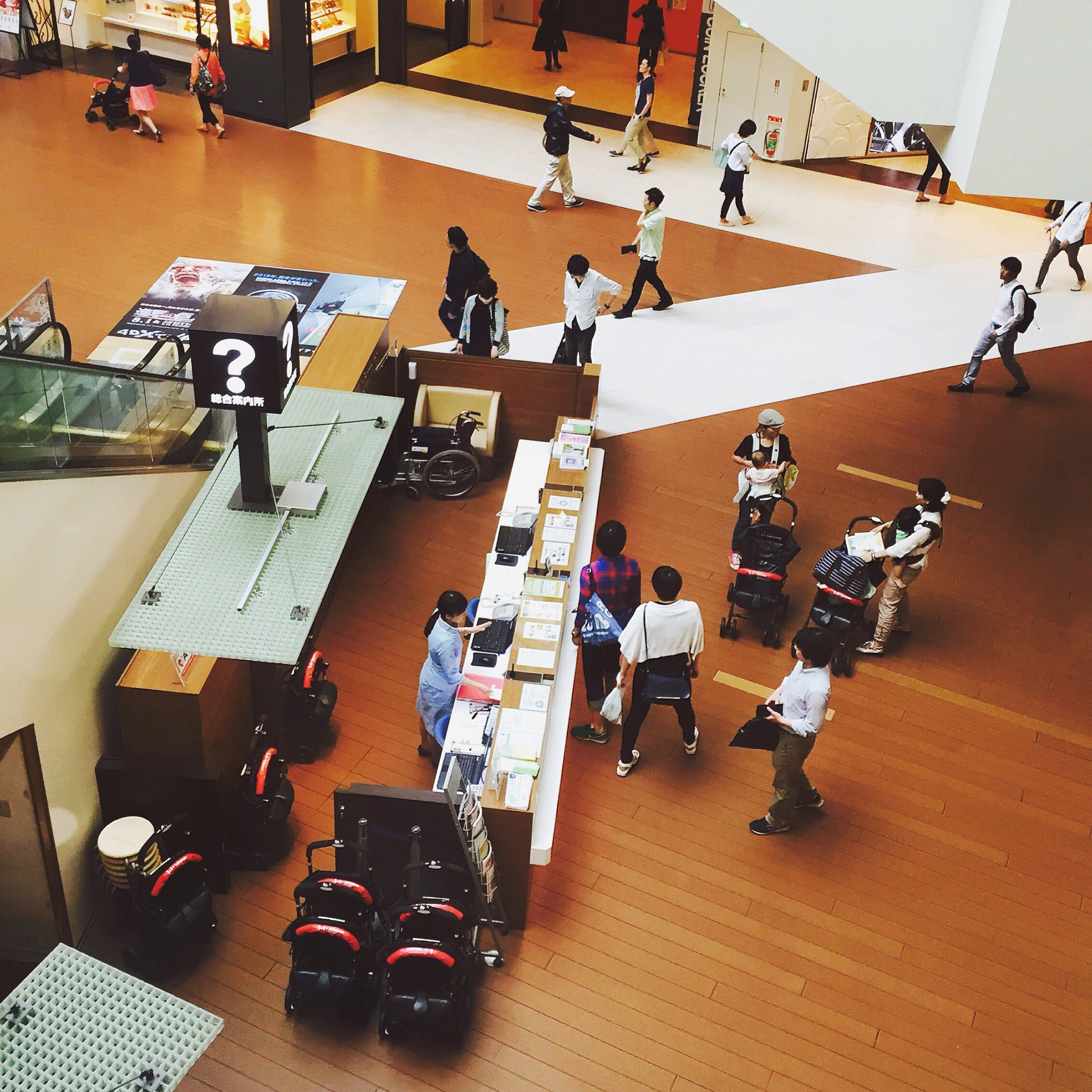indoors, men, large group of people, lifestyles, person, leisure activity, arts culture and entertainment, high angle view, medium group of people, performance, table, skill, music, togetherness, day, flooring, competition, group of people, shopping
