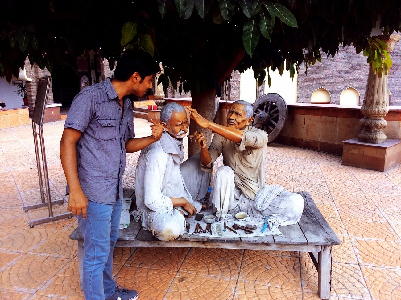 """""""Would you cut my hair too?"""". Thats what I'm trying to say to the sculptured man. This is a photo from museum of State History at Kurukshetra Univeraity. People Portrait People Working Having Fun People Photography Taking Photos Check This Out Haircut Time Haircut"""