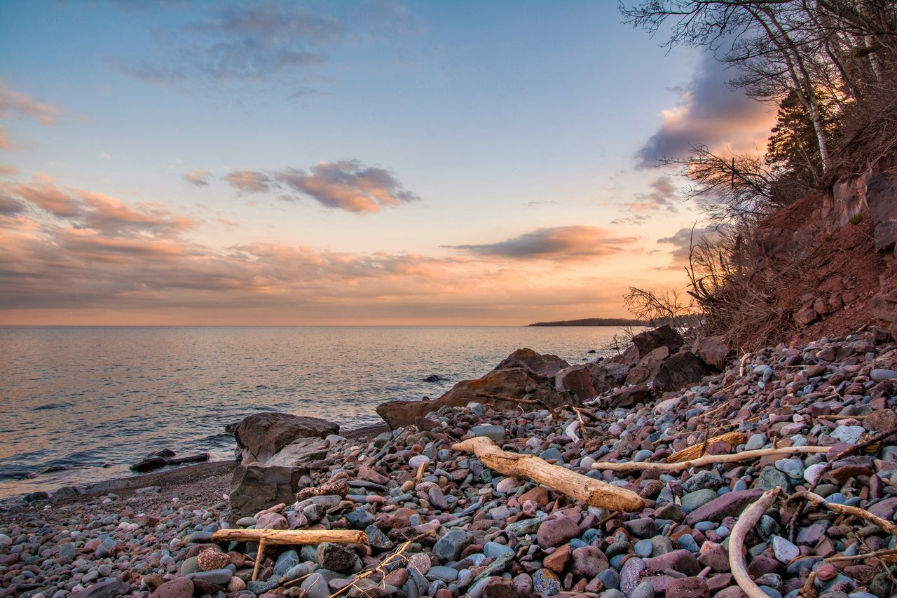 Lake Superior evening Beach Sunset Sea Pebble Horizon Over Water Day Pebble Beach Cloud - Sky Tranquil Scene Water Outdoors Malephotographerofthemonth Streamzoofamily Lake Superior Tranquility Beauty In Nature No People