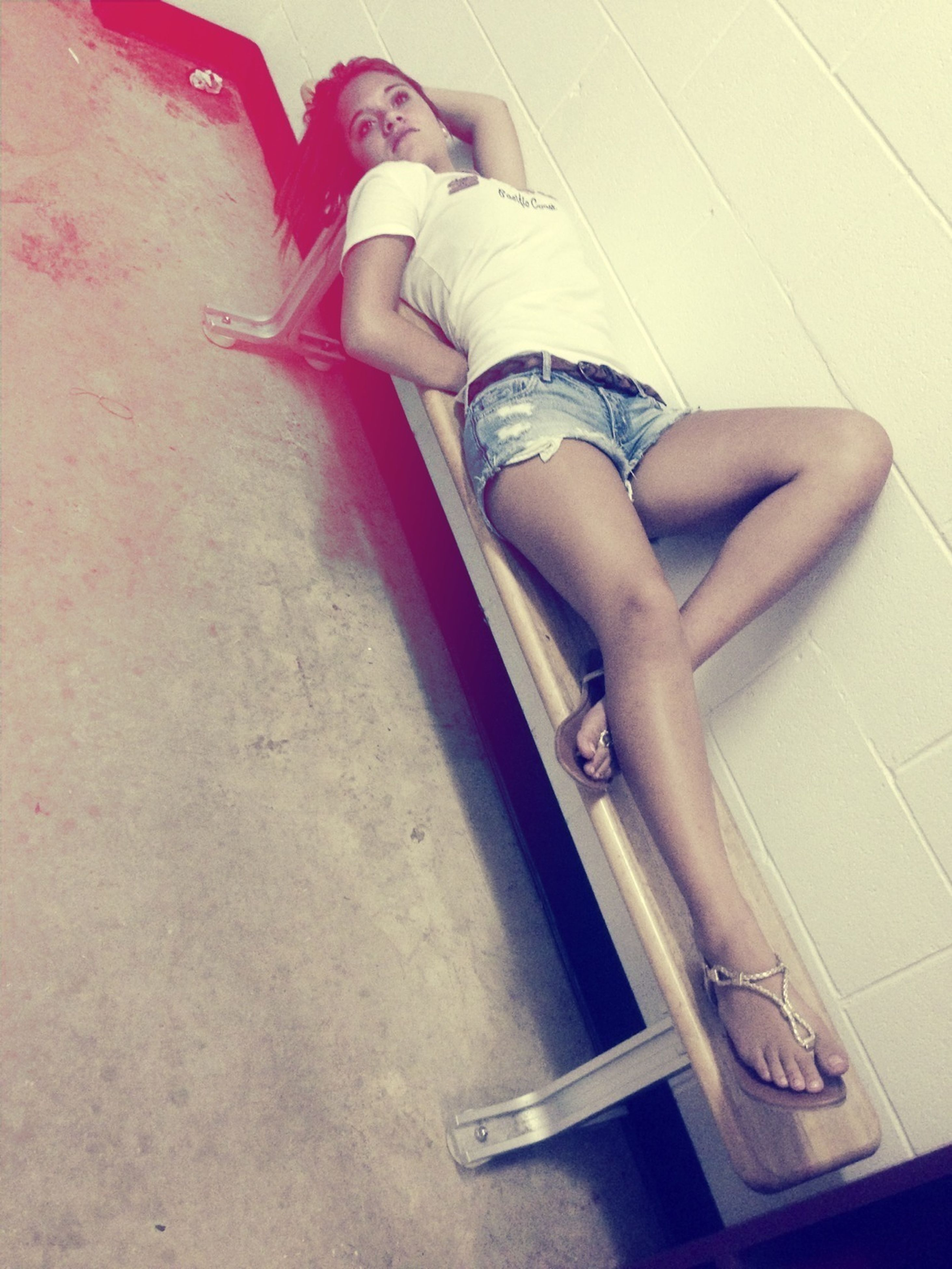 low section, indoors, person, high angle view, shoe, lifestyles, footwear, leisure activity, sitting, human foot, flooring, relaxation, wall - building feature, standing, high heels, fashion