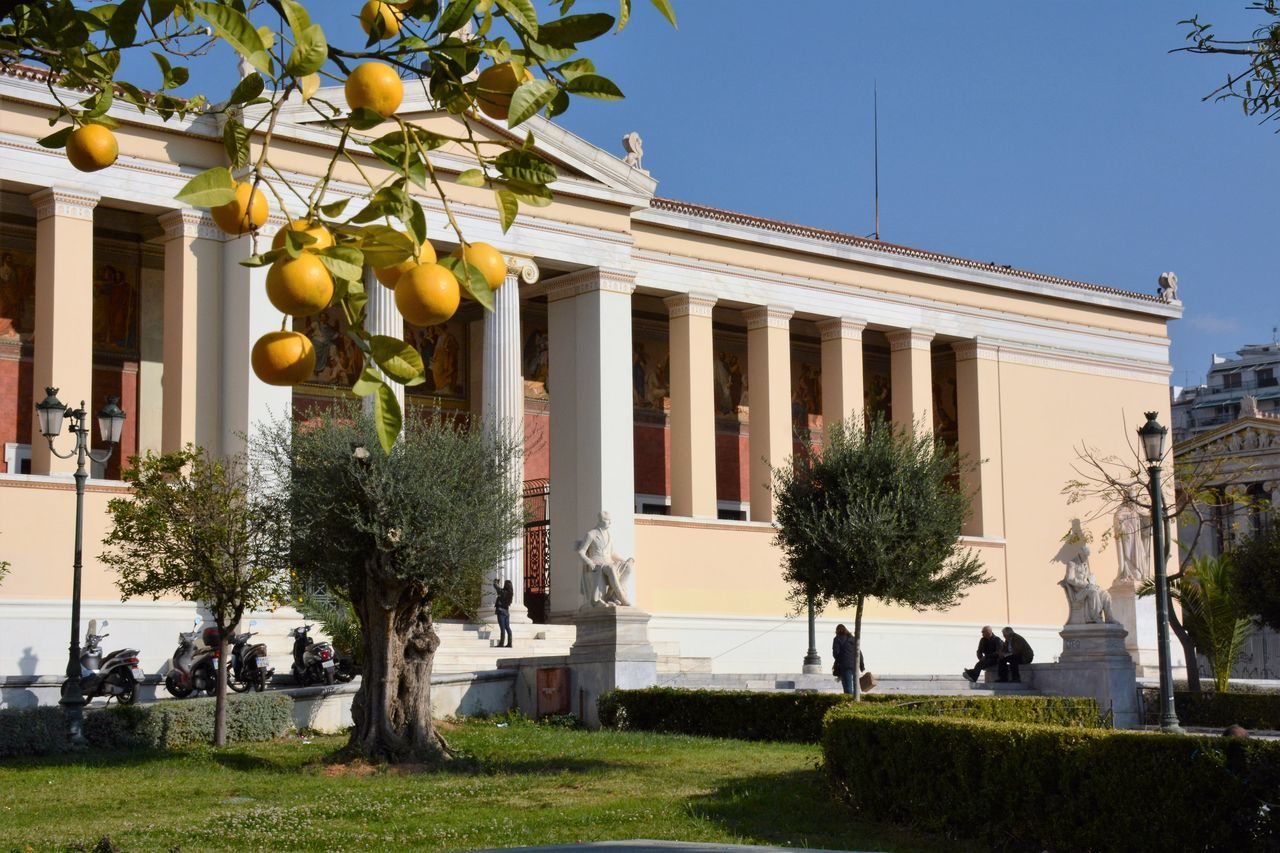 Academy of Athens Academy Academy Of Athens Architecture Athens Athens, Greece Beautiful Blue Sky Building Exterior Citrus Fruit City The City Light Day Greece Growth Lawn Nature No People Old Buildings Olive Tree Oranges Outdoors Sky Travel Destinations Tree Vacation The Architect - 2017 EyeEm Awards