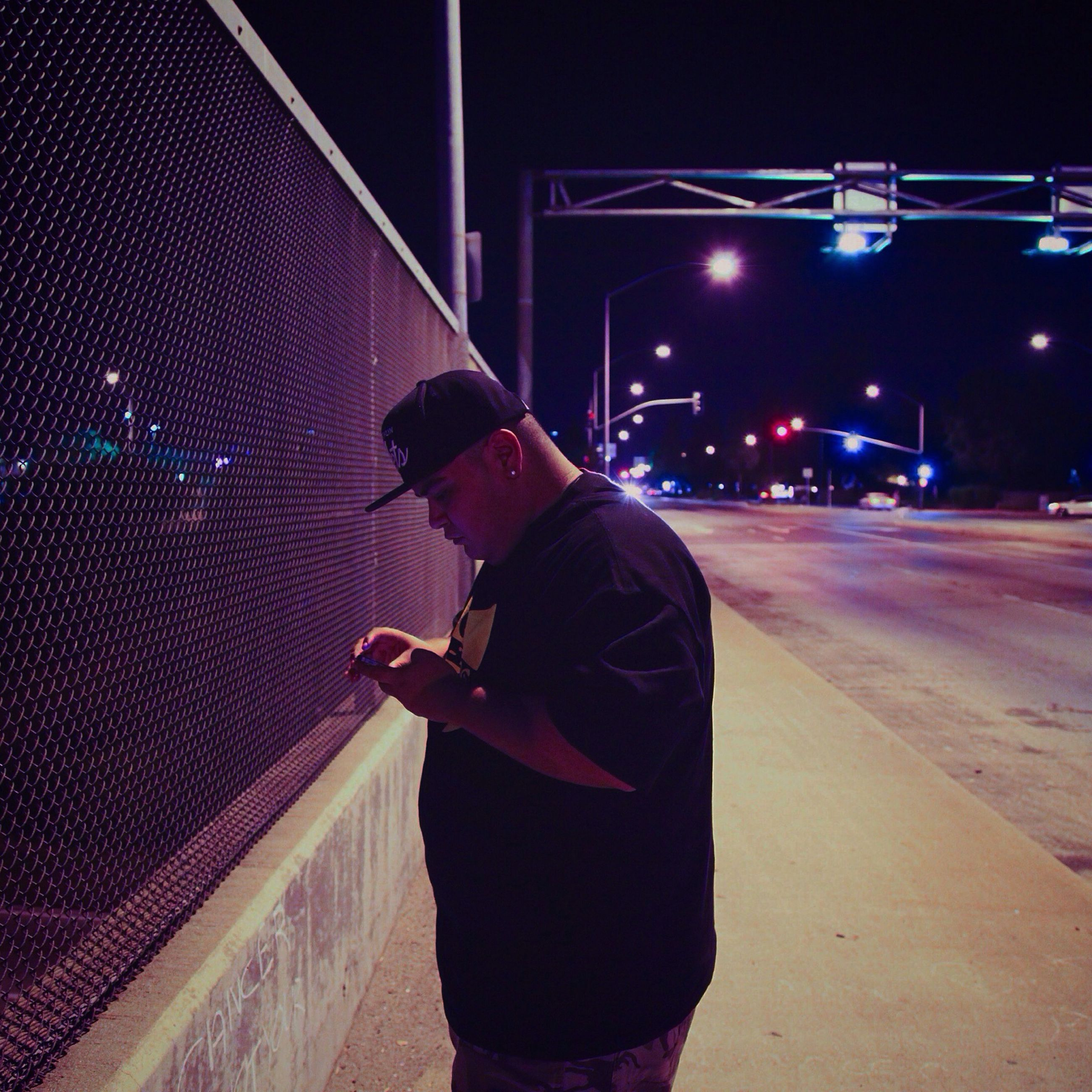 full length, rear view, lifestyles, night, casual clothing, illuminated, leisure activity, standing, street, men, holding, transportation, road, walking, three quarter length, city life, city, front view