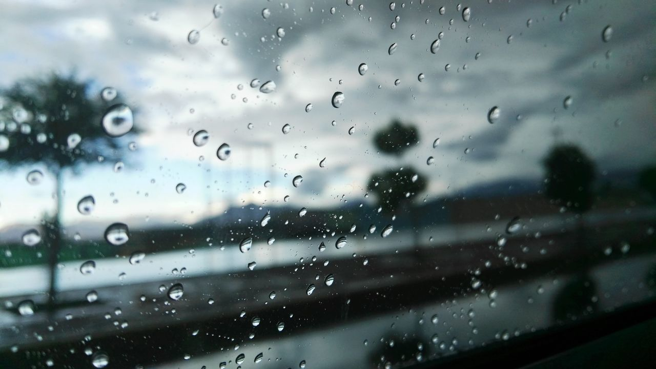 drop, window, wet, rain, rainy season, glass - material, raindrop, weather, water, no people, indoors, water drop, droplet, full frame, close-up, day, nature, backgrounds, sky, airplane