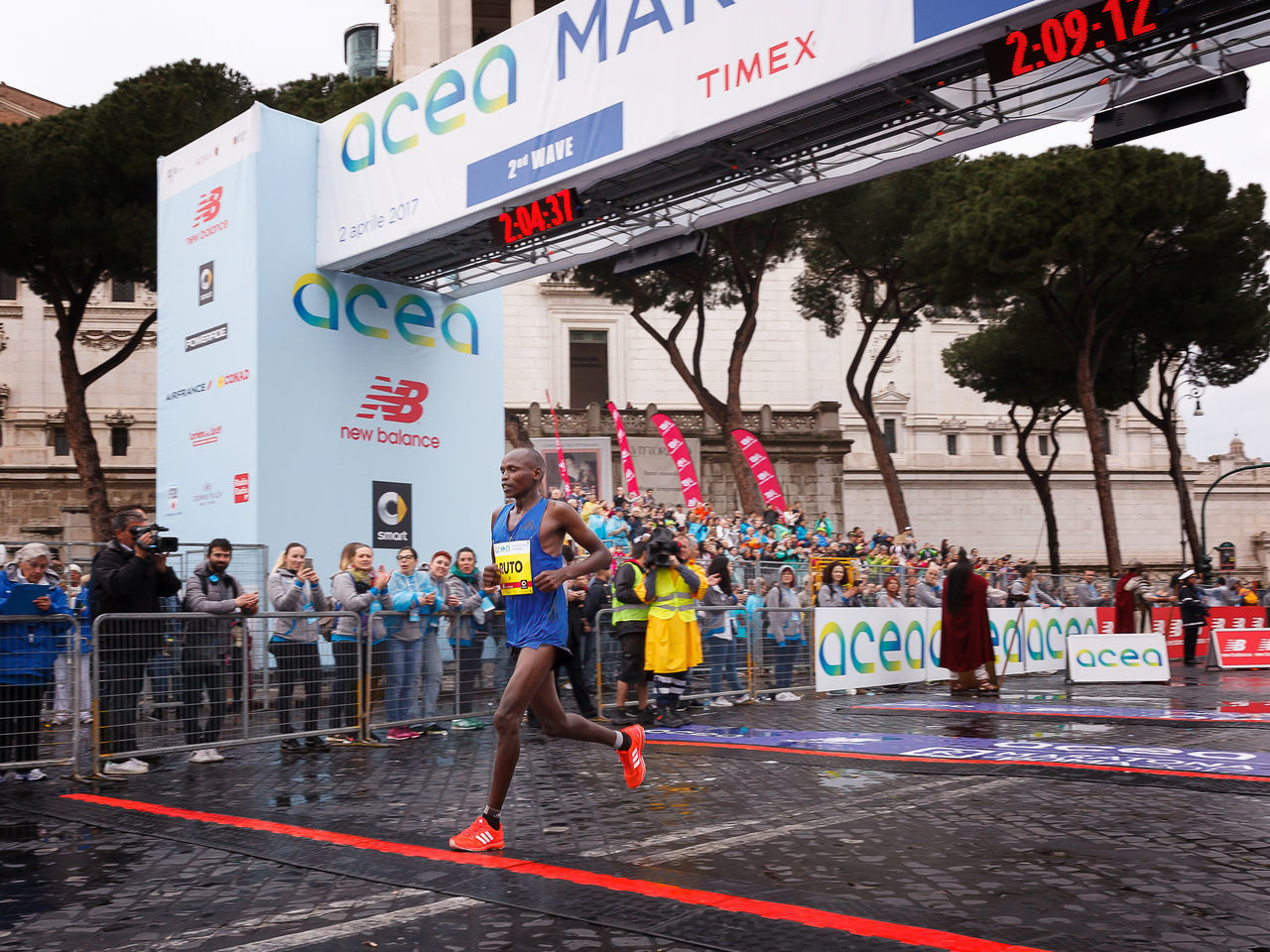 Rome, Italy - April 2, 2017: Ruto Dominic Kipngetich won the second place in the men's race, the 23rd Rome Marathon. Ruto on his arrival at the finish line. Adult Athlete City Day Finish Line  Kipngetich Marathon Marathonrunner Outdoors People Rome Marathon Rome Marathon 2017 Runner Ruto Ruto Kipngetich Sport Sport In The City Sportsman Winner