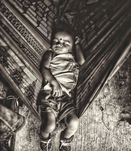 A womb is always peaceful, whether its a mother's womb or the one made by her. EyeEm Selects Privacyplease Sleepoflife Dreamingboy Leading Lines Sareeonwork Poverty Poverty Lives. Nexttodoor Peaceful Sleeper Goldensleep Indoors  Real People Day One Person Childhood Close-up Bed People
