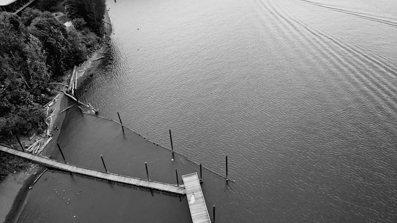 A couple having wedding photos taken by drone, which is flying just up and left from them. High Above Lines Black And White Blackandwhite Monochrome Distant Urban Geometry Portland Portland Oregon North Portland