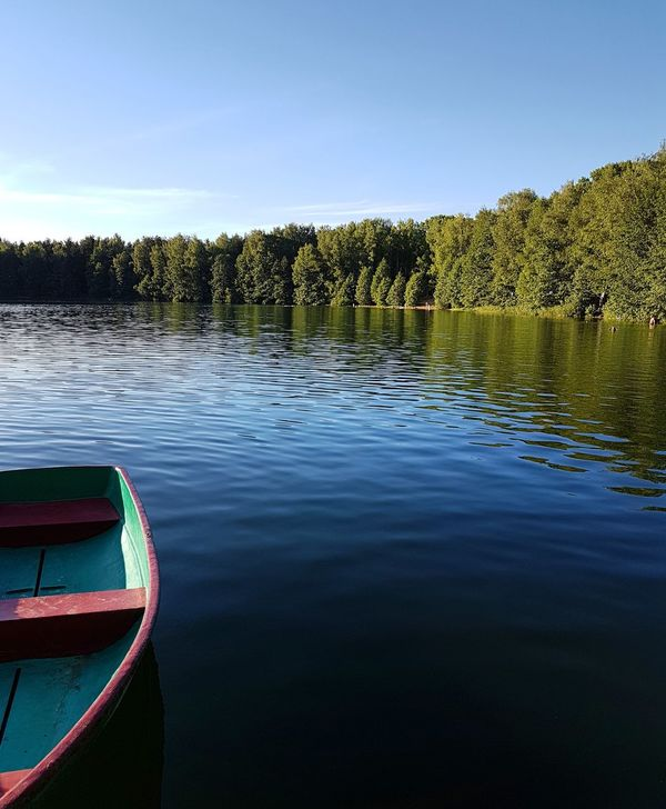 Beauty In Nature Boat Day Lake Nature No People Outdoors Sky Tranquility Tree Water