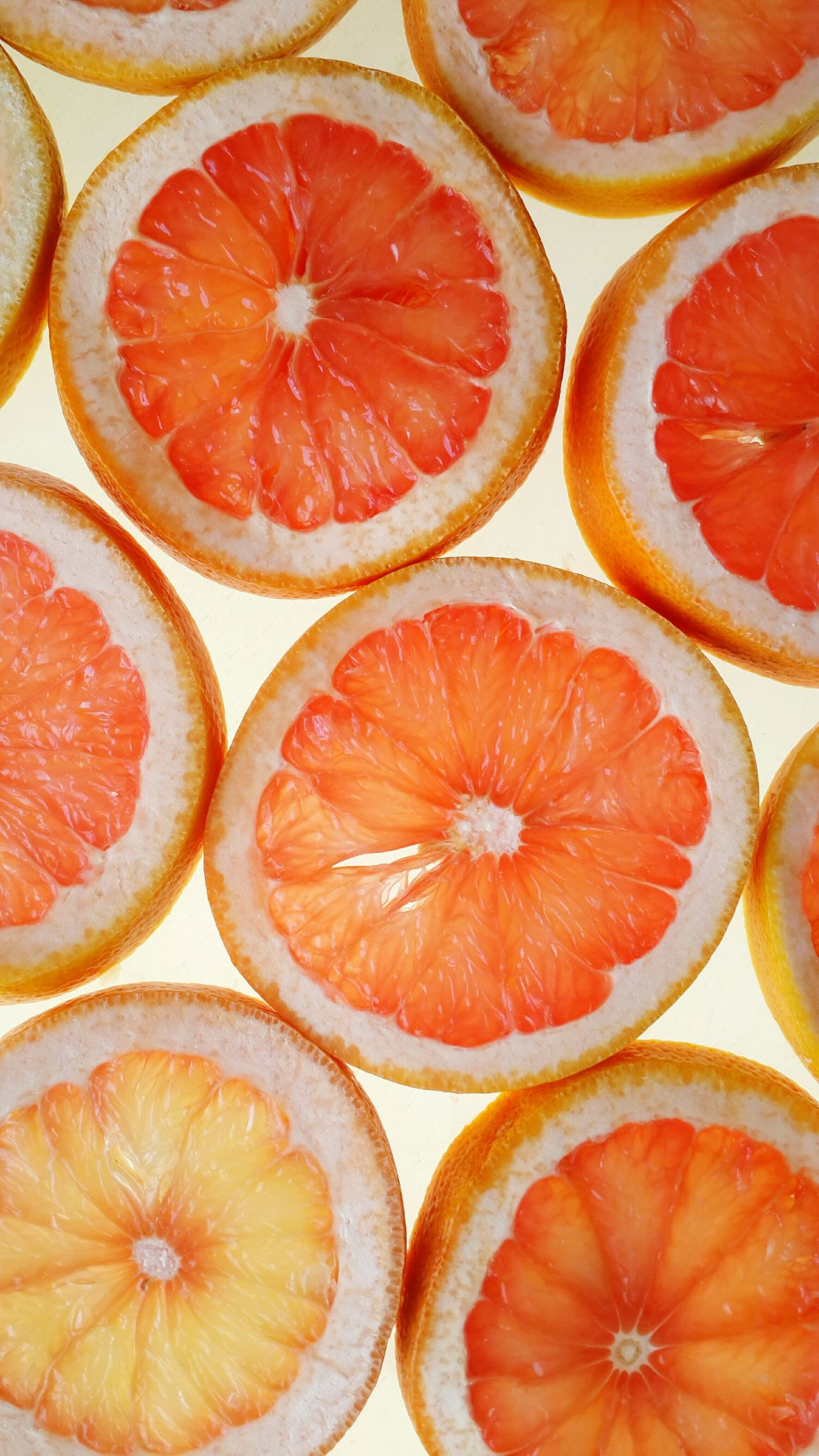 Full Frame Fruit SLICE Healthy Eating Citrus Fruit Cross Section Grapefruit Freshness High Angle View Pattern Backgrounds Circles Natural Pattern Pattern Pieces Blood Orange Sour Taste Food White Background Background Slices Healthy Food Citrus  Close-up Geometric Shapes Symmetry