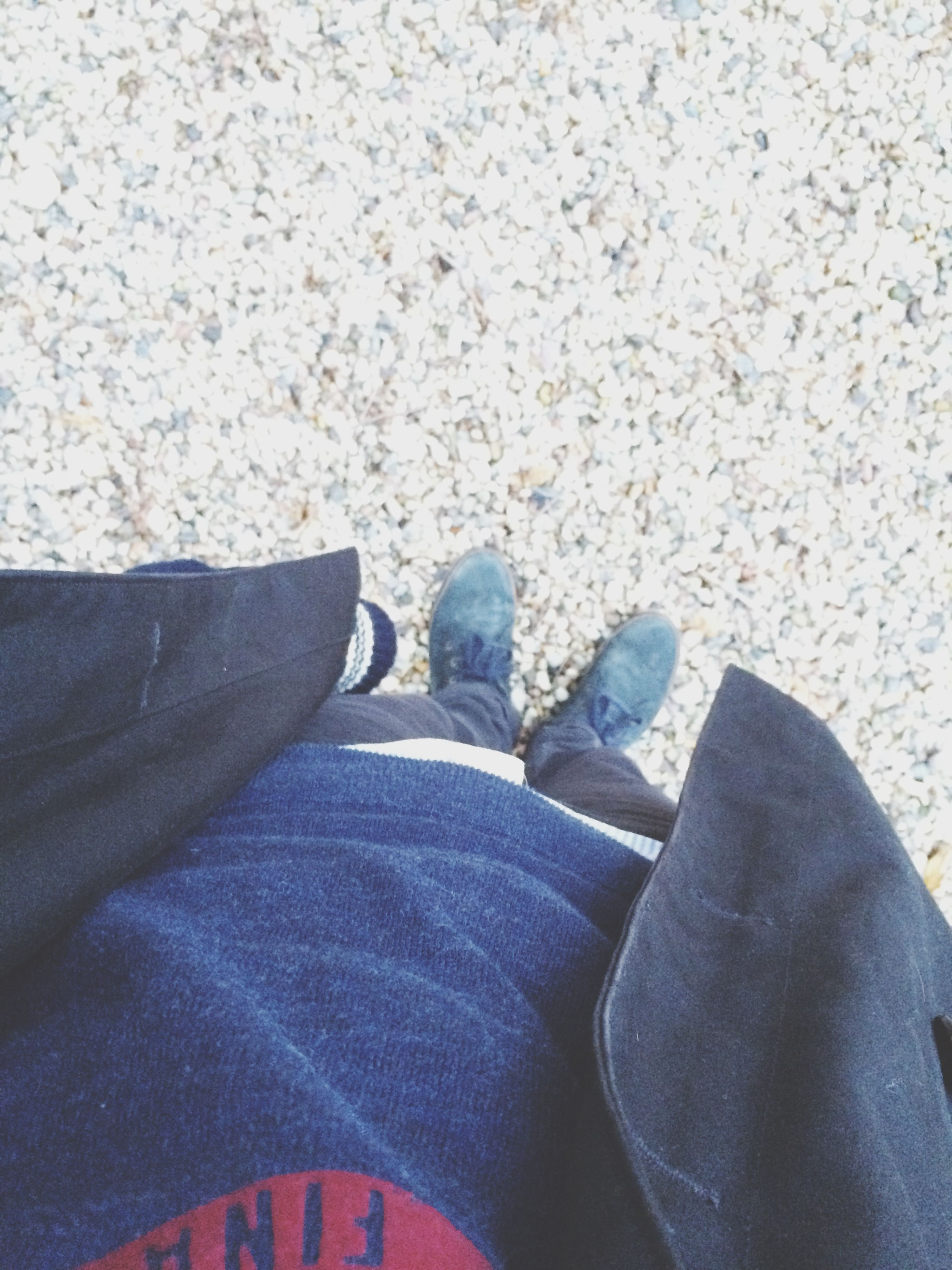 low section, person, shoe, personal perspective, jeans, lifestyles, high angle view, human foot, men, footwear, leisure activity, casual clothing, standing, relaxation, sitting, unrecognizable person, street