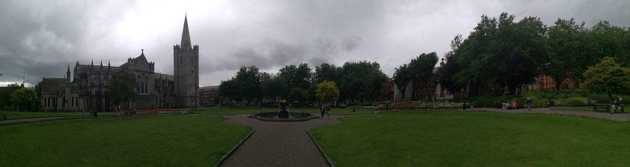 architecture, sky, built structure, history, building exterior, grass, travel destinations, outdoors, panoramic, tree, day, city, nature, no people