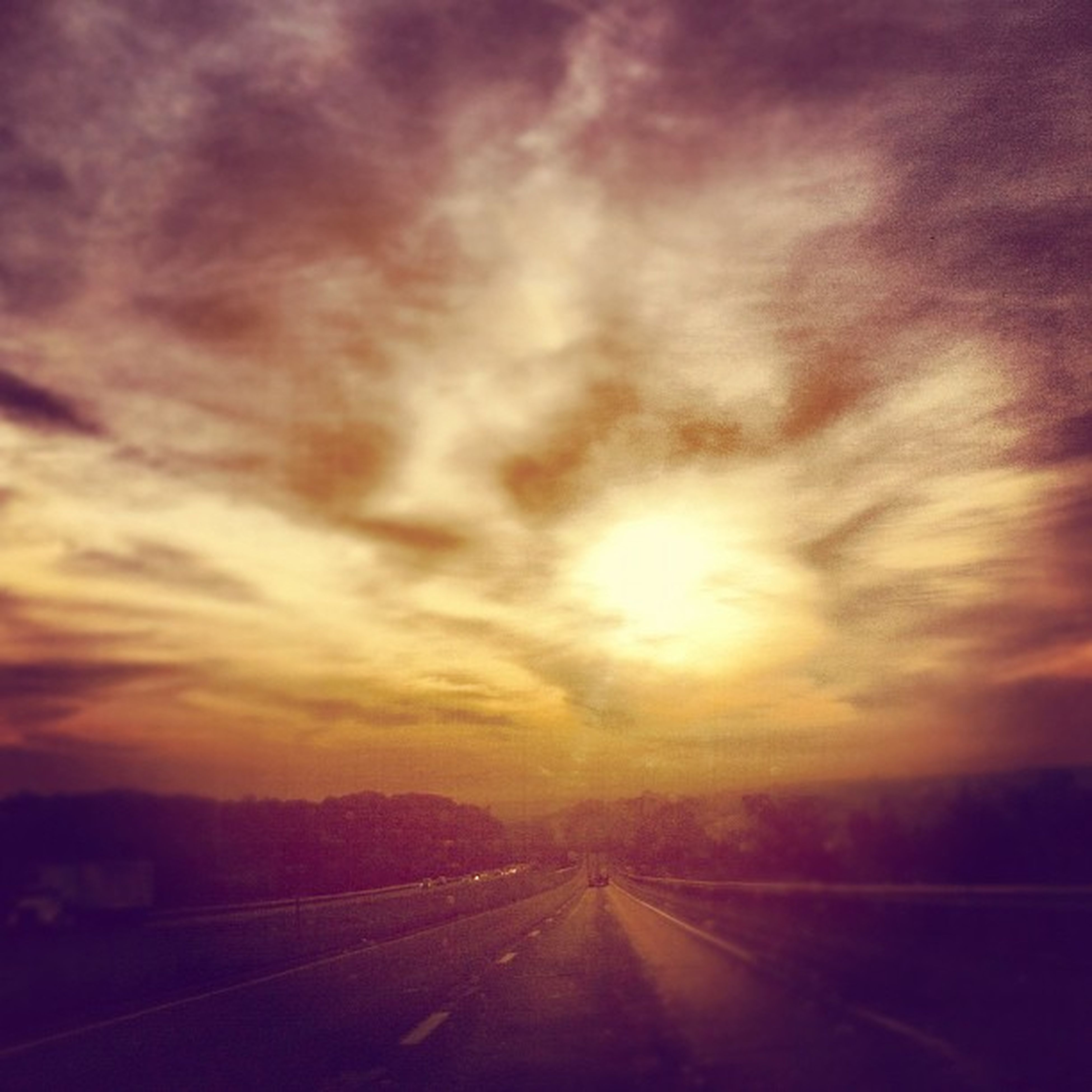 the way forward, sunset, sky, road, diminishing perspective, cloud - sky, transportation, vanishing point, tranquil scene, tranquility, scenics, beauty in nature, nature, dramatic sky, cloudy, landscape, orange color, weather, country road, road marking