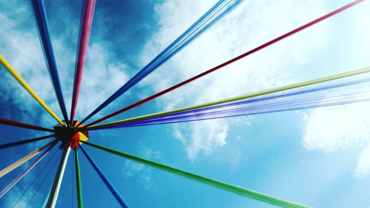 sky, cloud - sky, low angle view, blue, outdoors, multi colored, day, no people, shelter, ferris wheel, nature, close-up