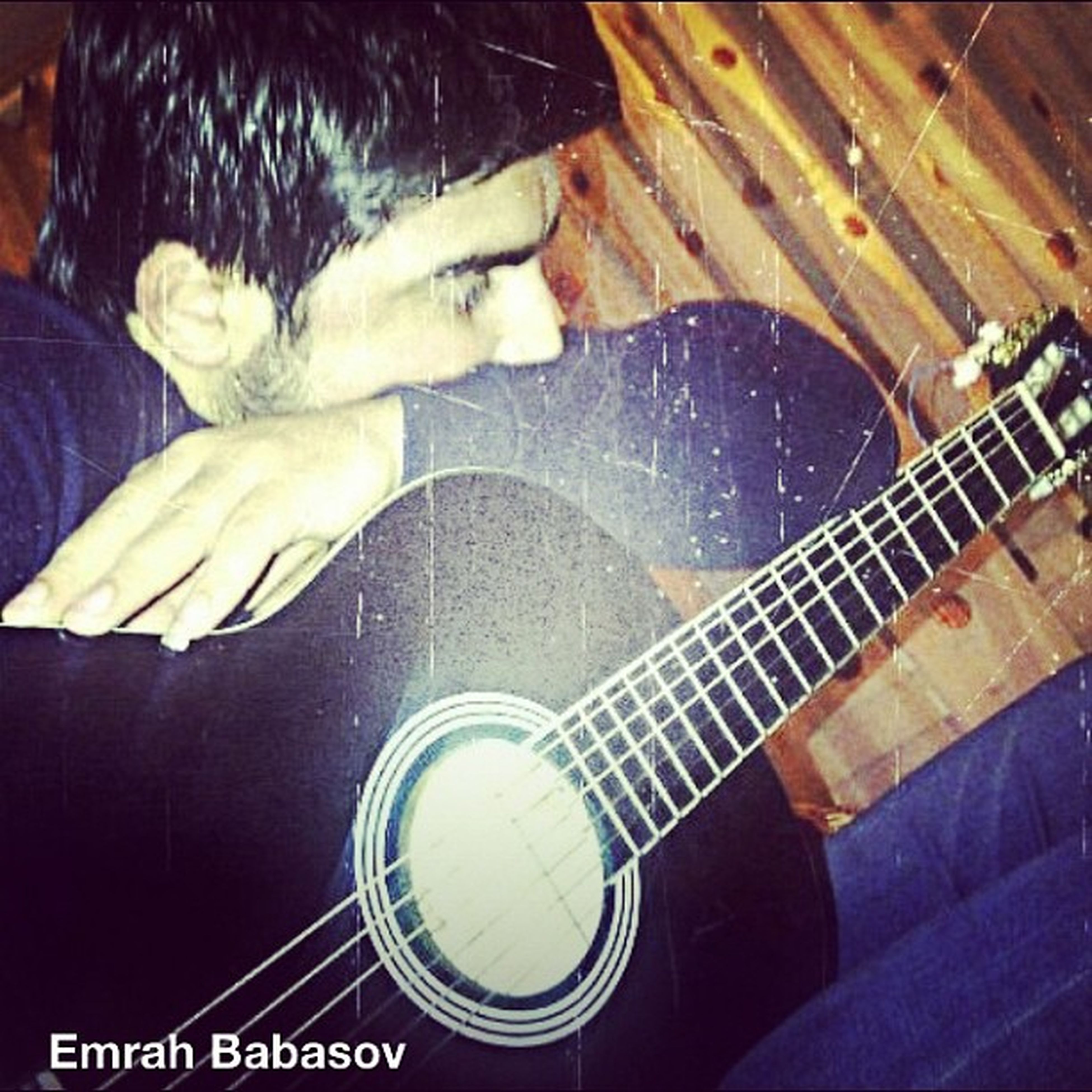 indoors, high angle view, lifestyles, men, leisure activity, sitting, music, occupation, casual clothing, musical instrument, technology, relaxation, working, guitar, arts culture and entertainment, playing, skill, holding