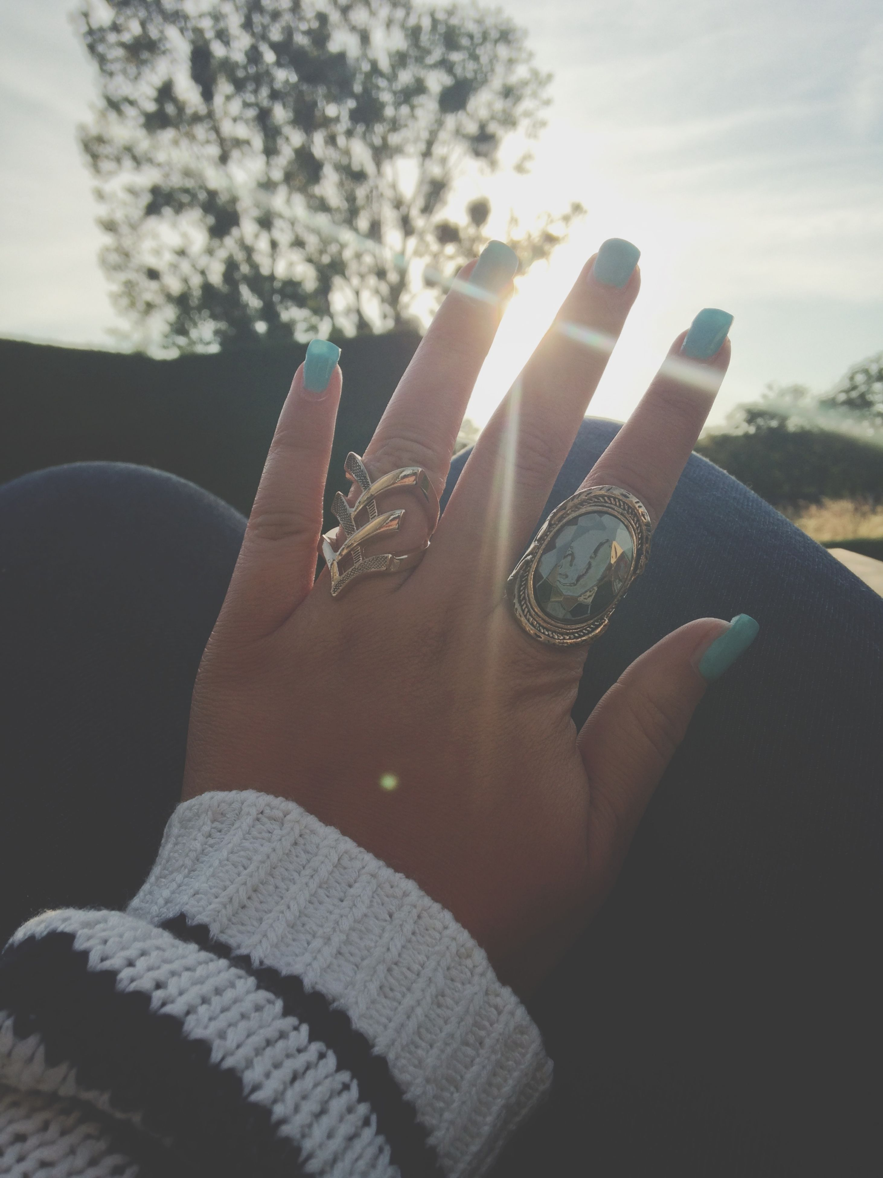 person, personal perspective, part of, lifestyles, leisure activity, human finger, cropped, sunlight, unrecognizable person, close-up, sky, low section, holding, men, day