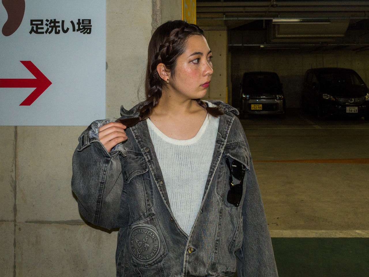 posing in a parking Black Hair Girl Casual Clothing Eurasian Grey In A Parking Lot Japanese Characters Japanese Girl One Person Panel People Real People Standing Underground Parking Young Adult Young Woman