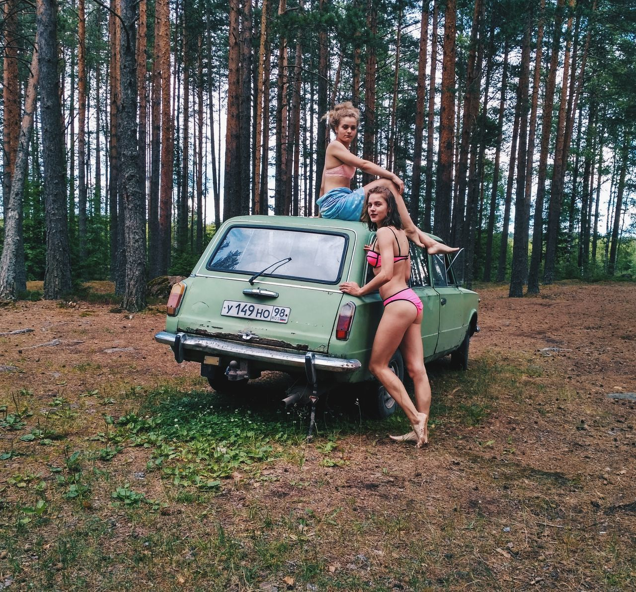 tree, two people, forest, young adult, car, young women, leisure activity, standing, full length, outdoors, beautiful woman, nature, day, fashion, real people, transportation, lifestyles, women, holding, smiling, adventure, togetherness, beauty in nature, adult, adults only, people
