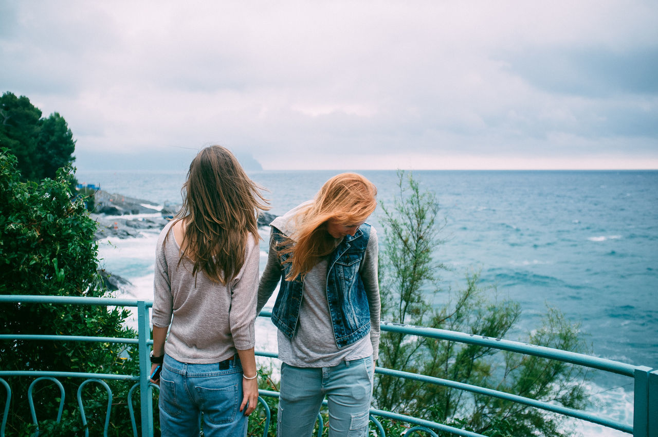 Two Young Women On Promenade
