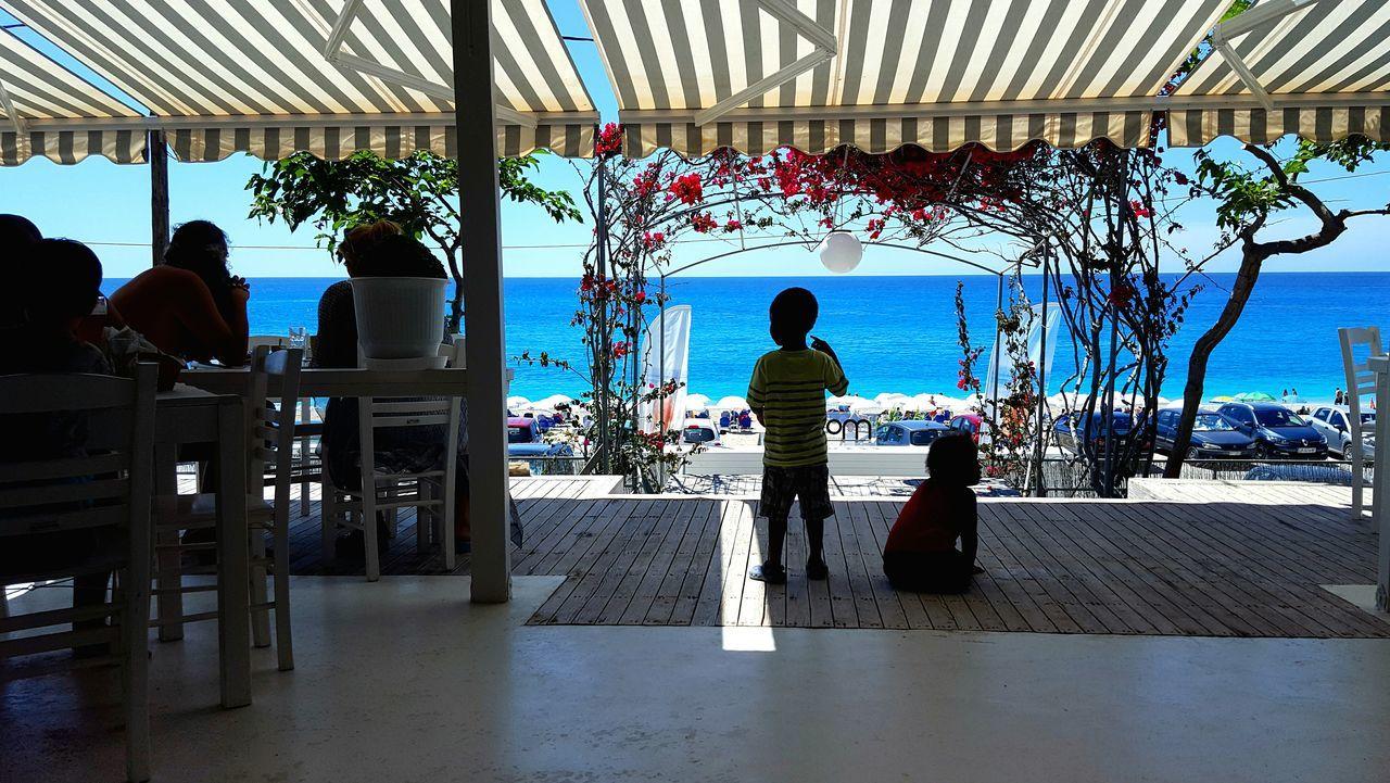 Tropical Climate Sunny Relaxation Travel Destinations Enjoyment Travel Lefkada Greece Kathisma Kathisma Beach Vacations Silhouettes Water Sea Summer Veranda Verandah Outdoors Restaurant Bar People Children