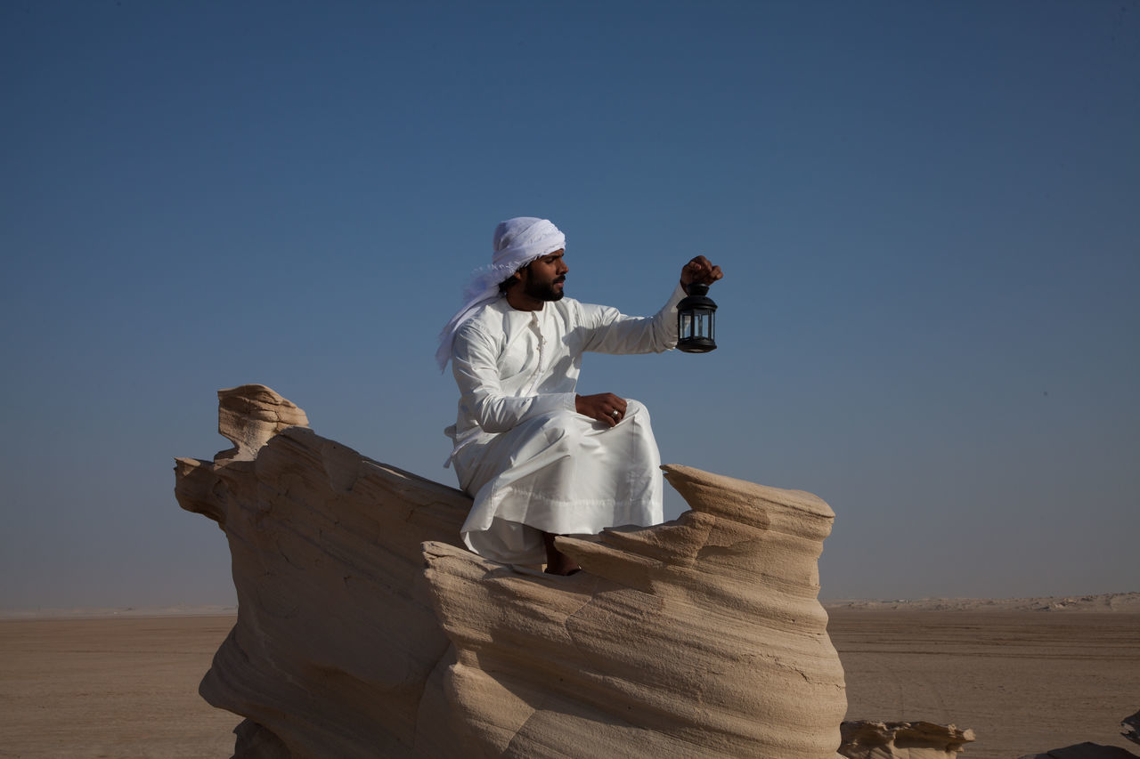 Arabic Arabic Style Arid Climate Clear Sky Day Desert Leisure Activity Nature One Person Outdoors People Real People Sand Sky Sunlight Young Adult