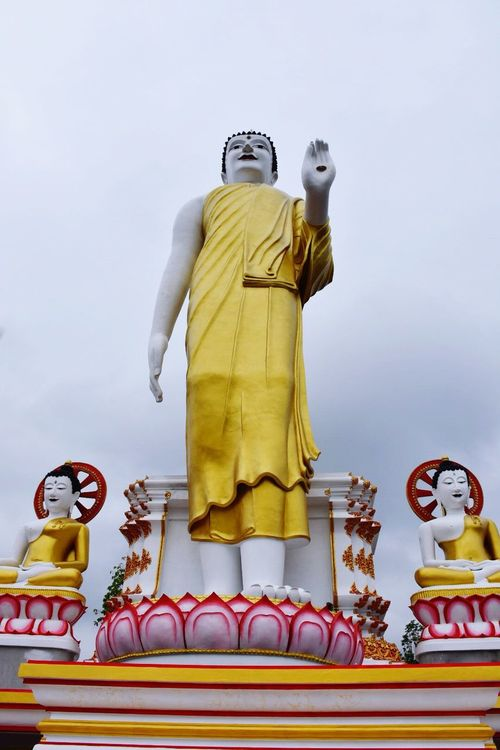 Statue Human Representation Male Likeness Sculpture Spirituality Religion Art And Craft Low Angle View No People Gold Colored Place Of Worship Idol Architecture Day Sky Outdoors King - Royal Person