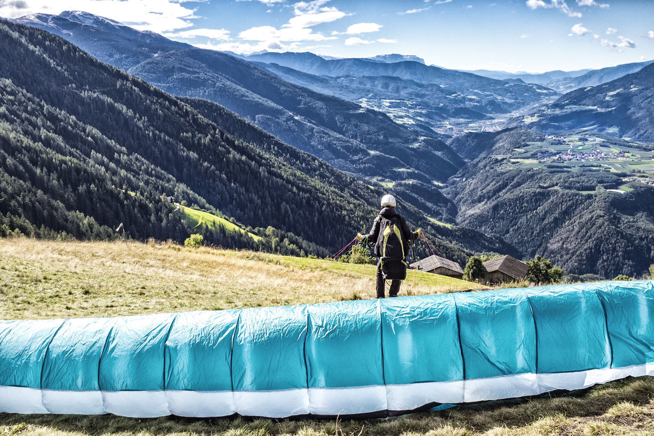Paraglider before start Adventure Alps Alto Adige Autumn Beauty In Nature Brixen /Bressanone Eisacktal Flying Freedom Isarco Jump Launch Launching Man Outdoors Panorama Paraglide Paraglider Paragliding Rear View Sports Start Südtirol Thrill Valley