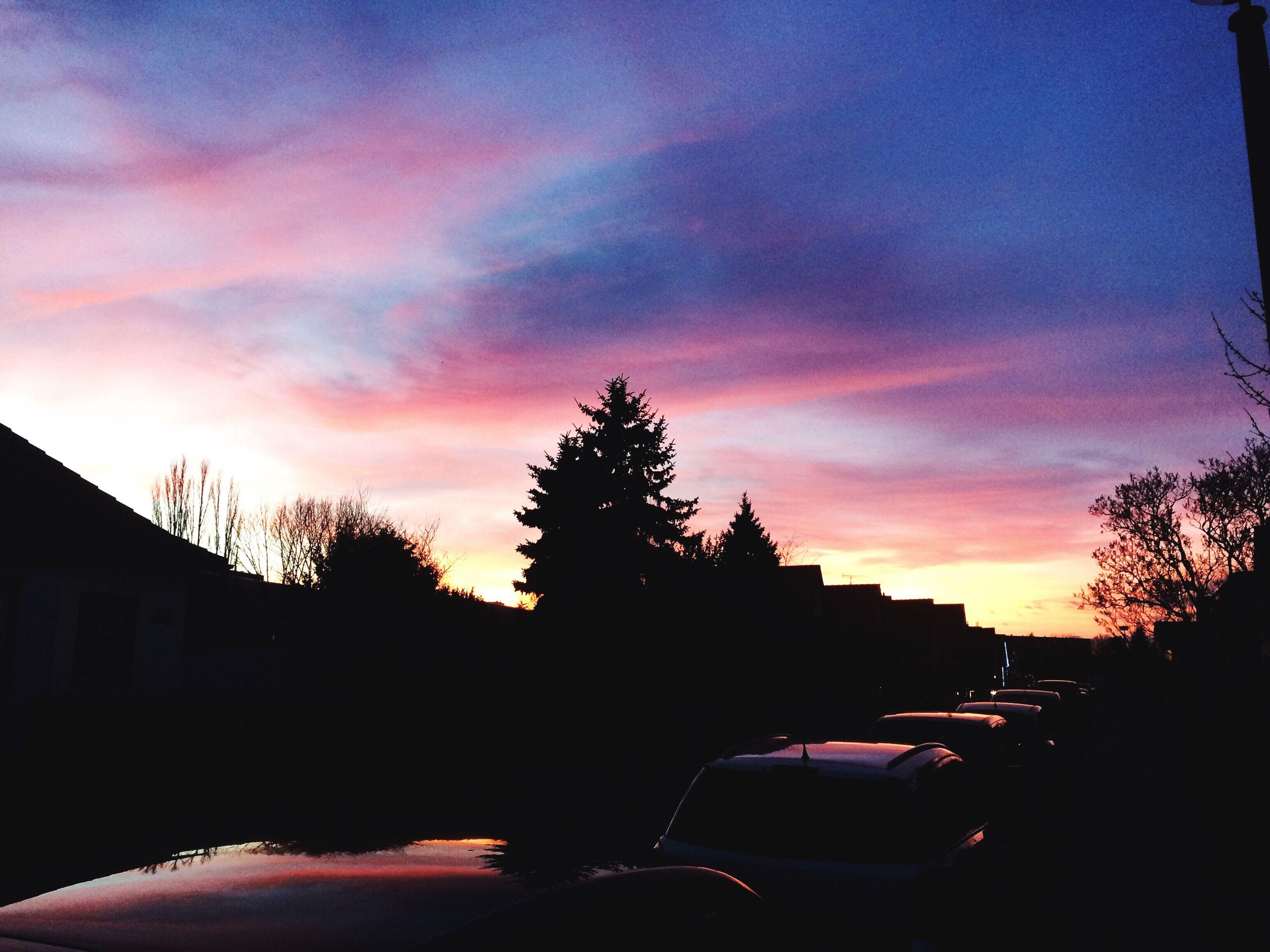 sunset, silhouette, sky, tree, building exterior, orange color, built structure, cloud - sky, architecture, car, land vehicle, dusk, beauty in nature, cloud, transportation, house, nature, outdoors, dramatic sky, dark