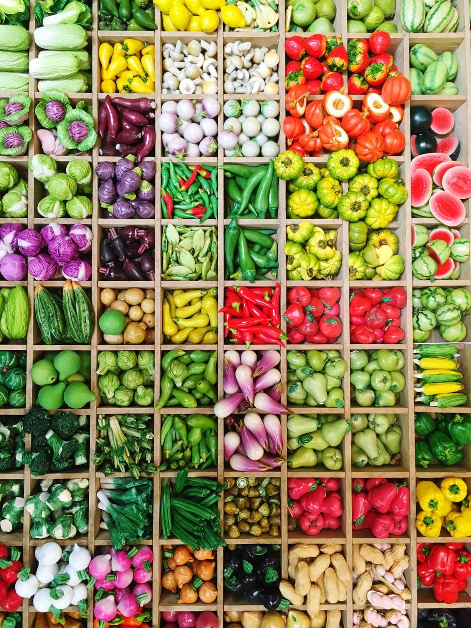 Full Frame Shot Of Various Artificial Vegetables For Sale At Market Stall