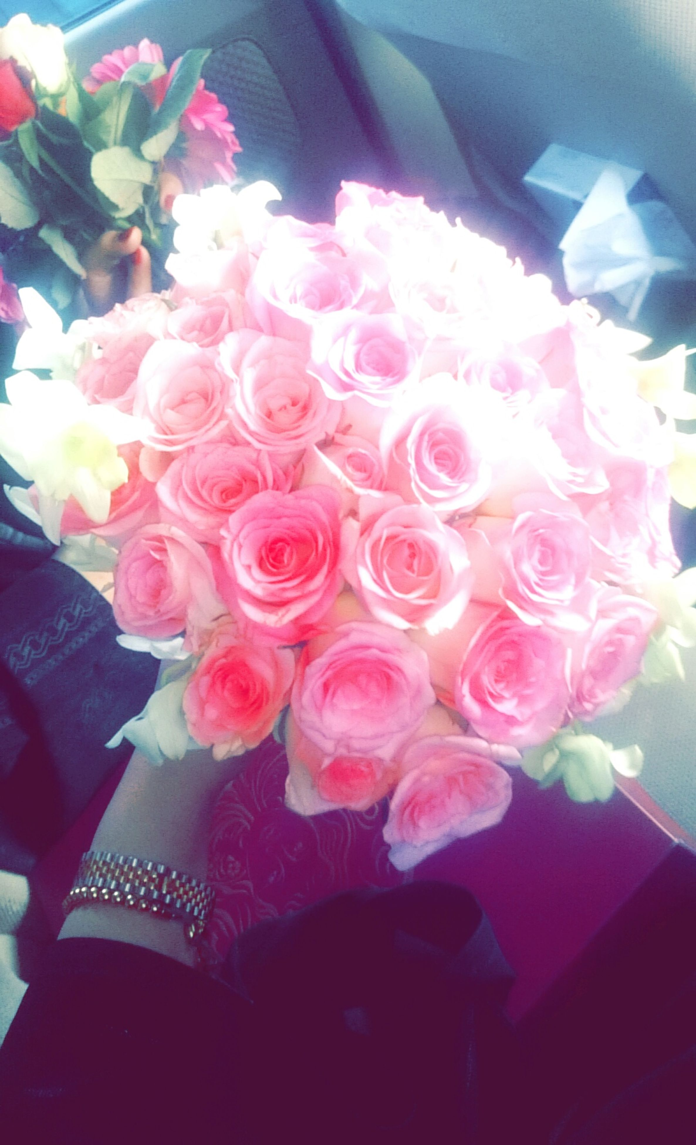 flower, indoors, freshness, petal, fragility, pink color, close-up, flower head, rose - flower, vase, high angle view, decoration, bunch of flowers, bouquet, table, home interior, beauty in nature, no people, flower arrangement, nature