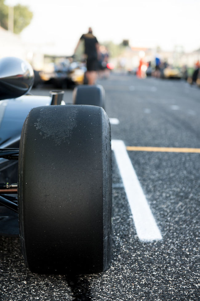 Racing wheel detail on motorsport track Car Cars Close-up Day Focus On Foreground Outdoors Race Racing Single Seater Starting Line Wheel