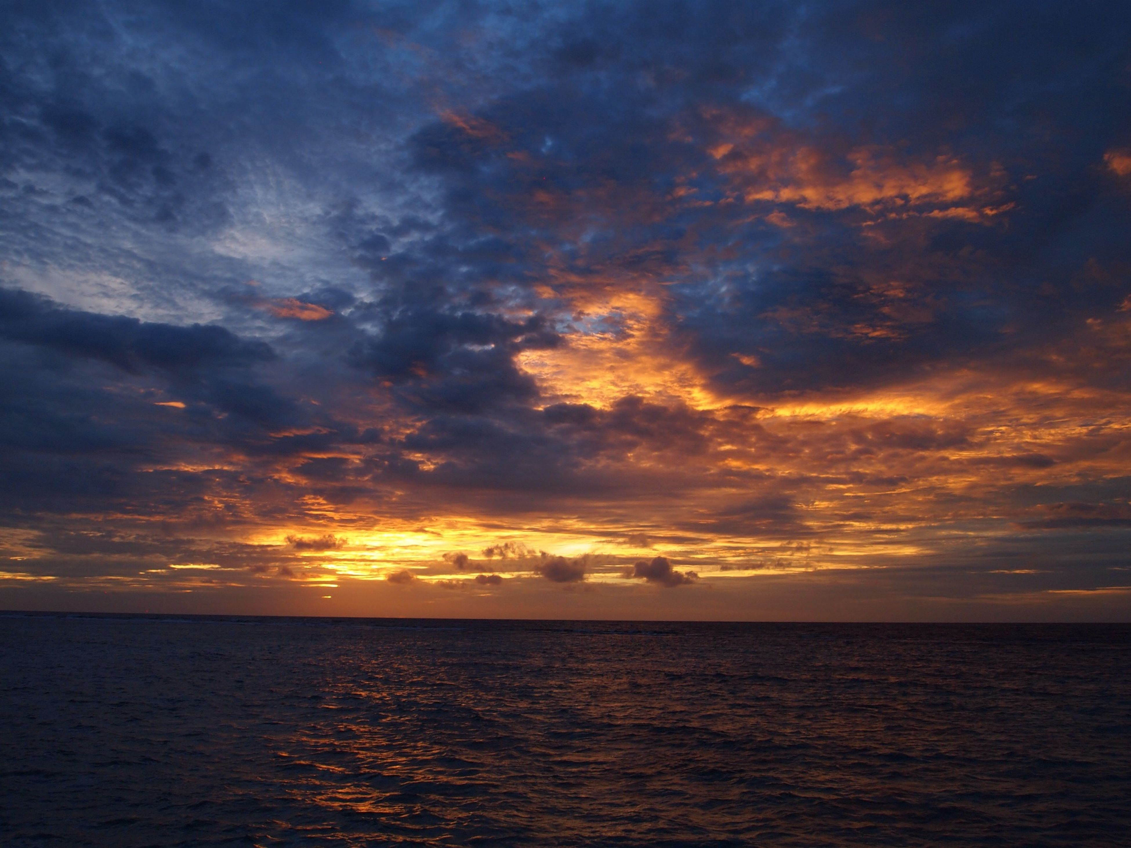 sunset, sea, scenics, sky, tranquil scene, beauty in nature, tranquility, horizon over water, water, waterfront, cloud - sky, orange color, idyllic, nature, cloud, cloudy, dramatic sky, rippled, moody sky, seascape