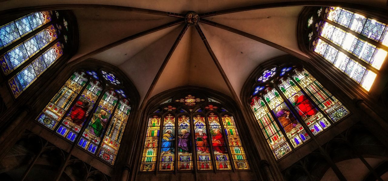 religion, place of worship, stained glass, window, indoors, spirituality, architecture, arch, built structure, multi colored, pew, no people, day