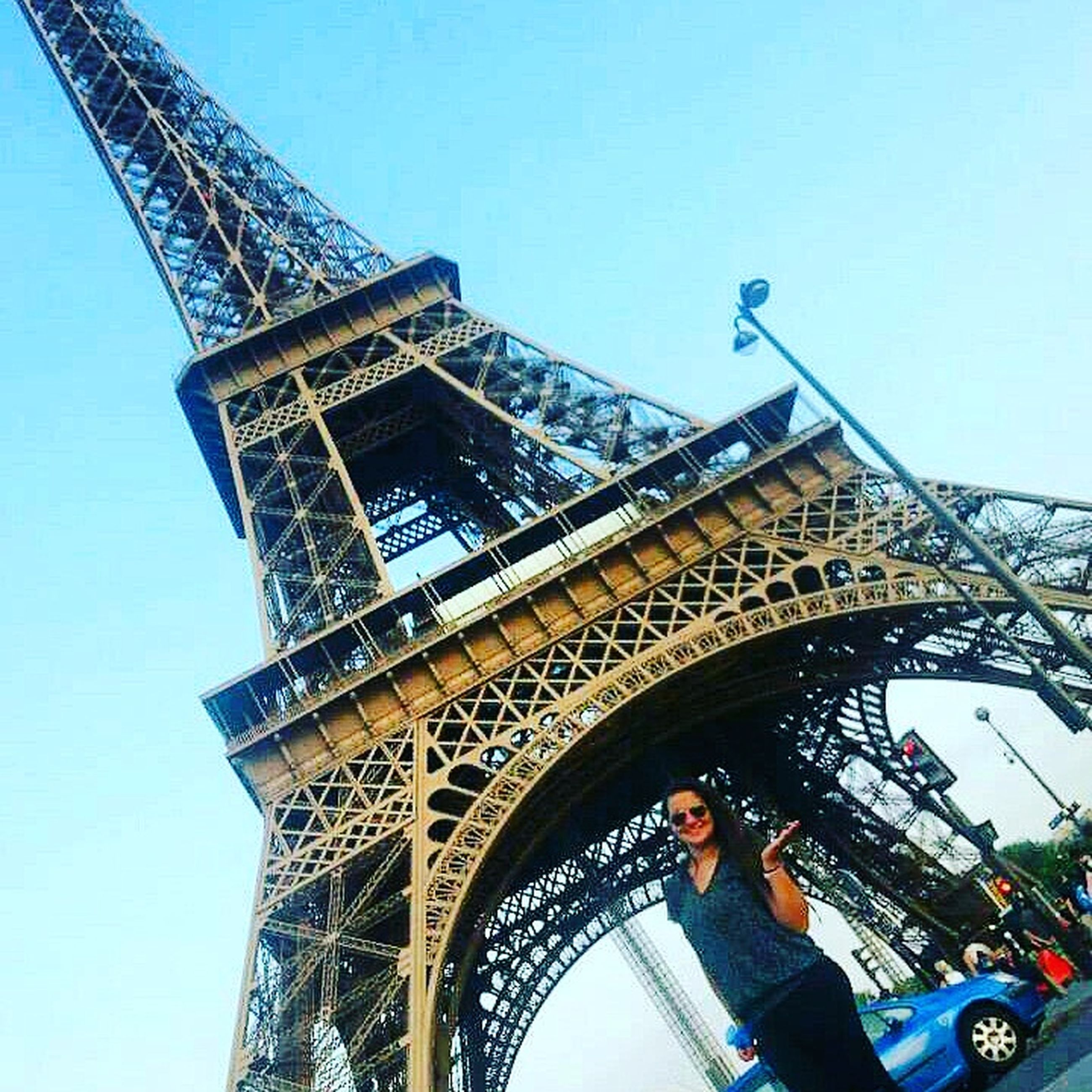architecture, built structure, clear sky, low angle view, famous place, international landmark, capital cities, tower, travel destinations, travel, tourism, building exterior, blue, engineering, copy space, leisure activity, metal, city, eiffel tower