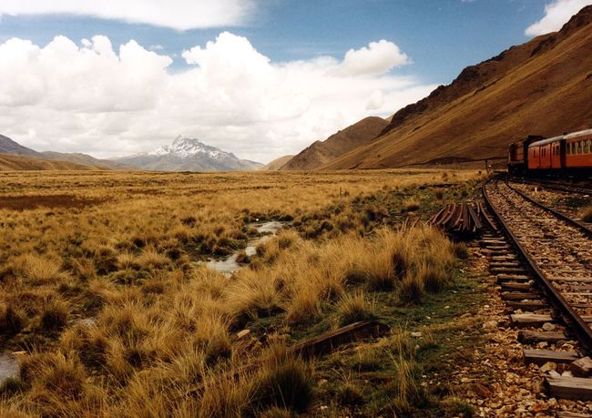 The EyeEm Collection The Journey Is The Destination Plateau Of The Andes Plateau Andes Anden Railway Railroad from Cusco to Puno Peru 4000 M High Titicaca Lake Railroad Track Peru Rail Andean Explorer Train Journey Steppe Drought Mountain Travel Snow Fresh On Eyeem  South America Getty Images Premium Collection