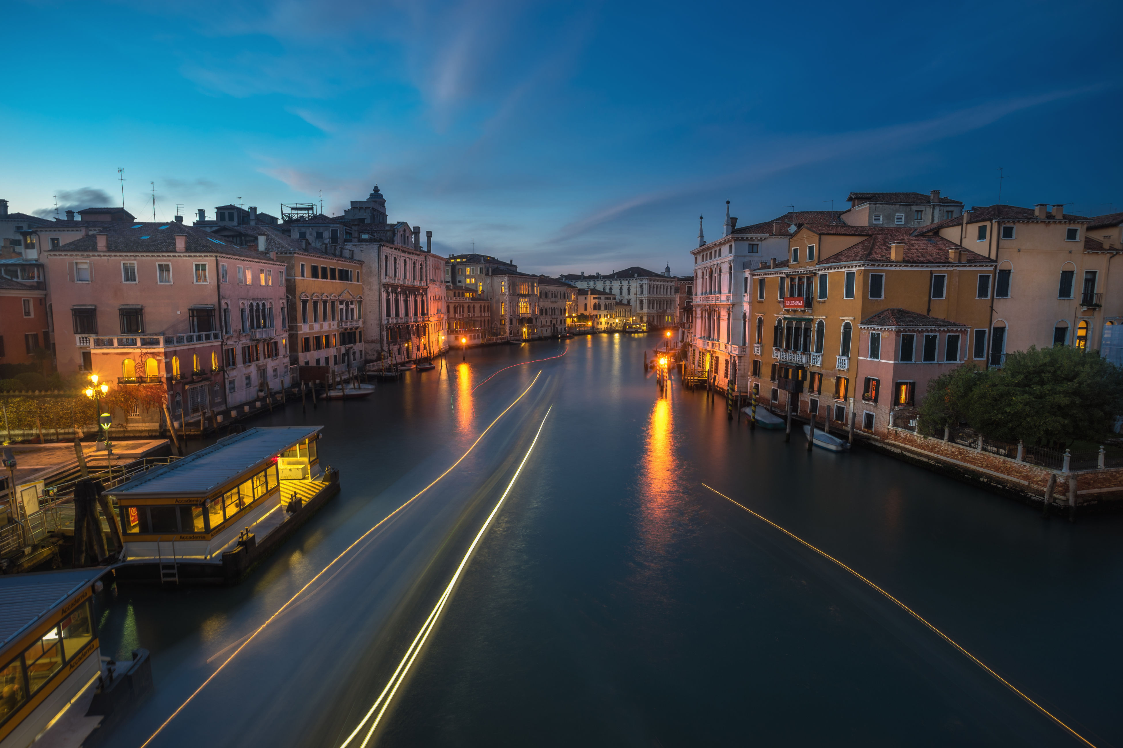 water, illuminated, architecture, city, reflection, sky, transportation, built structure, building exterior, canal, high angle view, nautical vessel, cityscape, bridge - man made structure, waterfront, sunset, no people, outdoors, connection, night