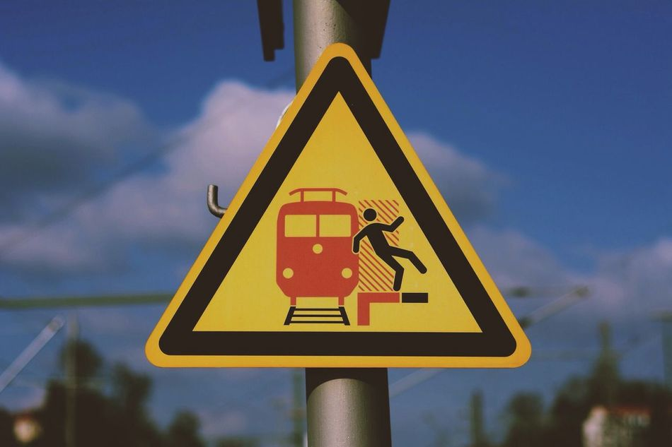 Yellow Communication Road Sign Close-up Guidance Sign Symbol Information Sign Sky Pole Focus On Foreground Geometric Shape Outdoors Vibrant Color Day Hanging Out The Week Of Eyeem Train Popular EyeEm Best Shots Check This Out Vscocam Popular Photos VSCO