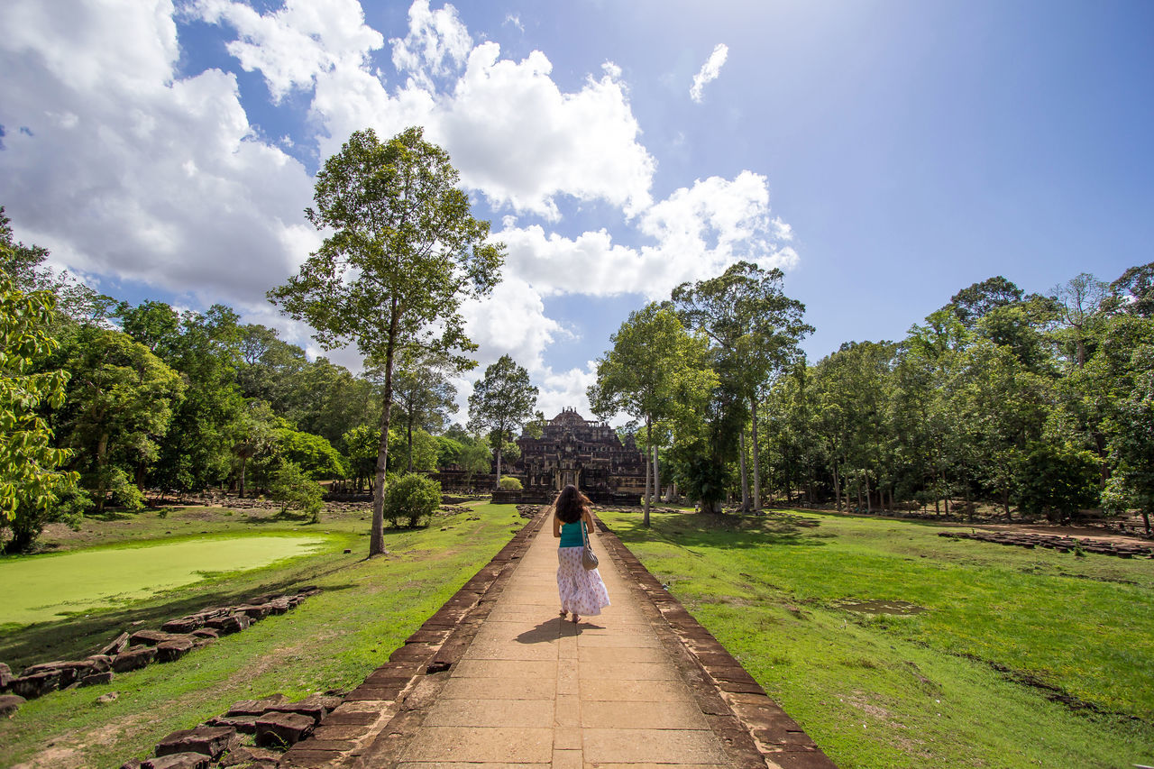 Beauty In Nature Cloud - Sky Day Full Length Grass Growth Leisure Activity Nature One Person Outdoors People Real People Scenics Sky The Way Forward Tree Walking Women Angkor Thom Walking Forward