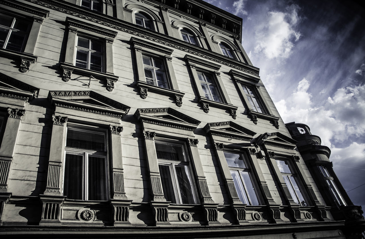 low angle view, architecture, building exterior, window, sky, outdoors, facade, history, no people, cloud - sky, day, built structure, city