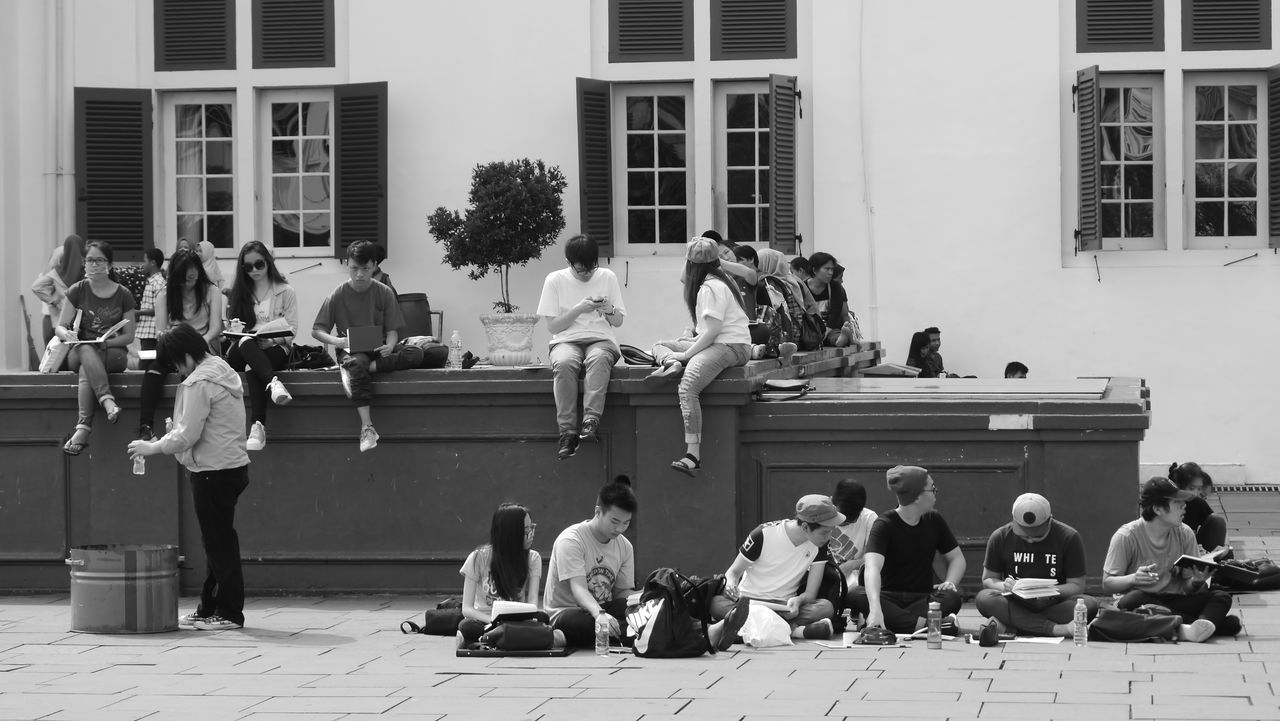 The Street Photographer - 2017 EyeEm Awards Archival Large Group Of People Full Length People Adult Sitting Building Exterior Men Boys Standing Day Occupation Women Student Indoors  Young Adult Only Men