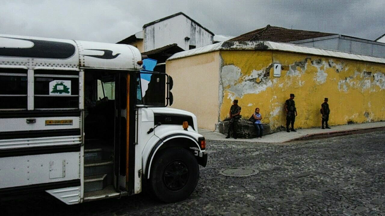 Antigua Antigua, Guatemala AntiguaGuatemala Antigua Guatemala Lifestyles Latin Culture Everyday Lives Lifestyle Outdoors Soldiers Streetphotography Street Photography Bus Everyday Life Street Life Tension Guards Police Day On The Street On The Street Corner Street Corner