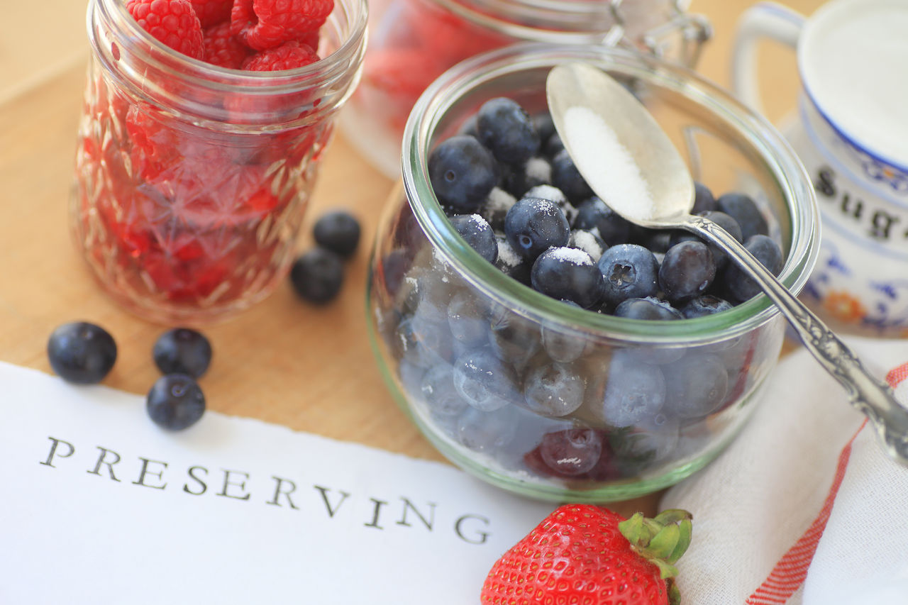 Fresh berries with glass jars Blueberries Copy Space Cutting Board Fabric Fresh Fruits Glass Jars Indoors  Letters Making Jam Natural Light No People Overhead Paper Perserving Raspberries Spoon Strawberries Sugar Sweet Sweet Food Textures Word