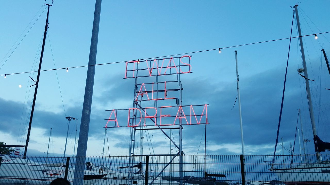 It Was All A Dream NOSALIVE Portugal Nosalive17 Sky Clouds Metal Technology Cable Barbed Wire Electricity  Steel No People Day Cloud - Sky Outdoors Electricity Pylon Red Letters Lisbon Business Finance And Industry Boats Close-up Taking Photos