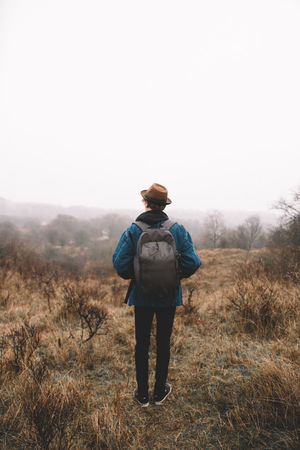 Always fun these adventures on gloomy days! | full length adult one person one man only standing casual clothing travel destinations Wanderlust tranquil scene EyeEmNewHere EyeEm Selects Hiking misty morning Netherlands foggy morning Nature rural scene Agriculture forest adventure gloomy gloomy weather Hat Backpacking backpack