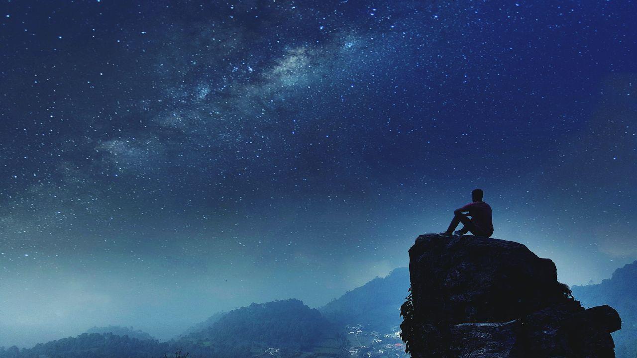 Beautiful stock photos of galaxy,  25-29 Years,  Blue,  Cliff,  Horizontal Image