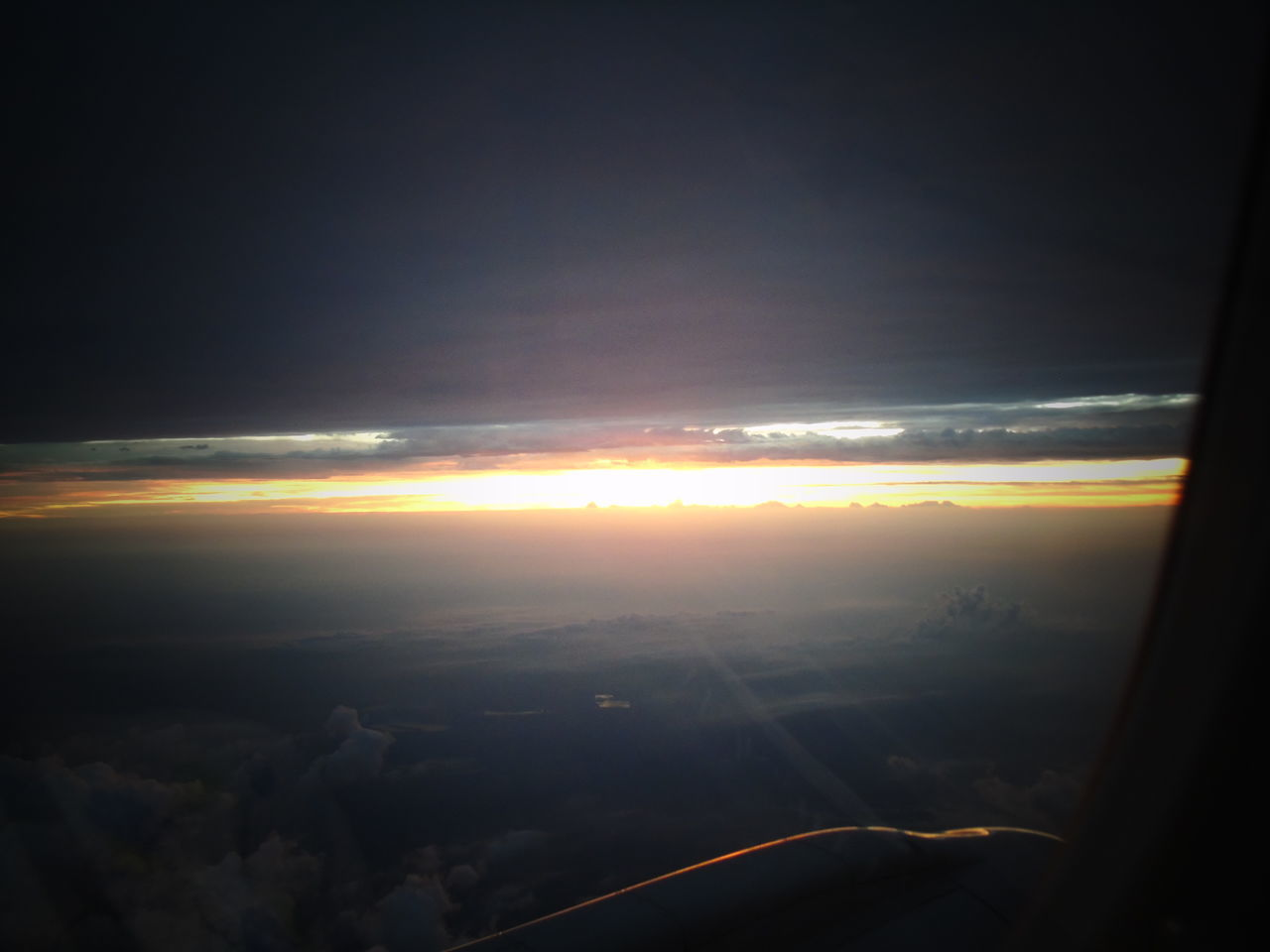 sunset, cloud - sky, aerial view, scenics, beauty in nature, nature, tranquil scene, tranquility, sky, landscape, airplane, transportation, no people, journey, outdoors, flying, airplane wing, day