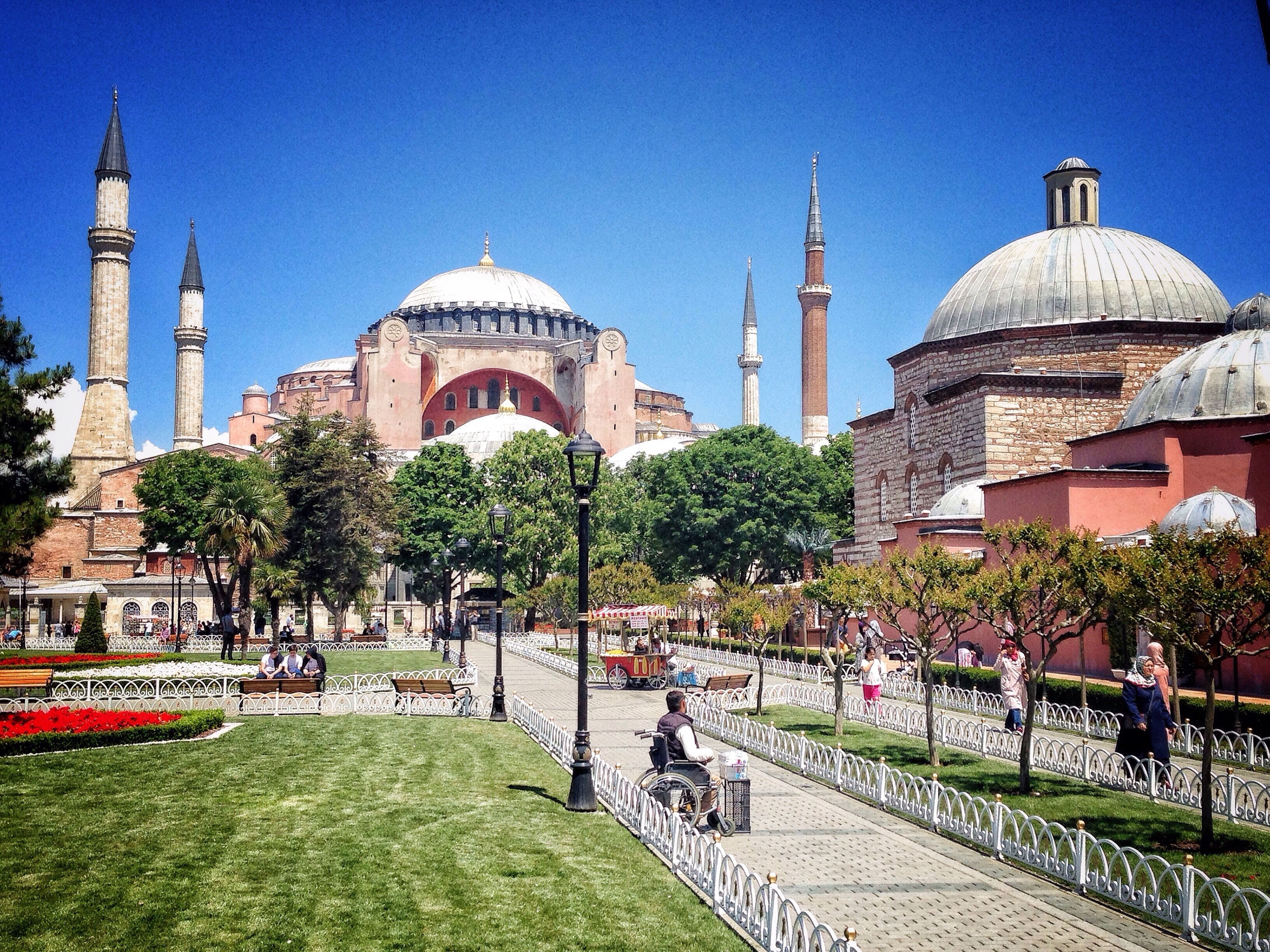 architecture, built structure, building exterior, famous place, dome, place of worship, religion, clear sky, tourism, travel destinations, travel, blue, international landmark, tree, spirituality, islam, mosque, incidental people