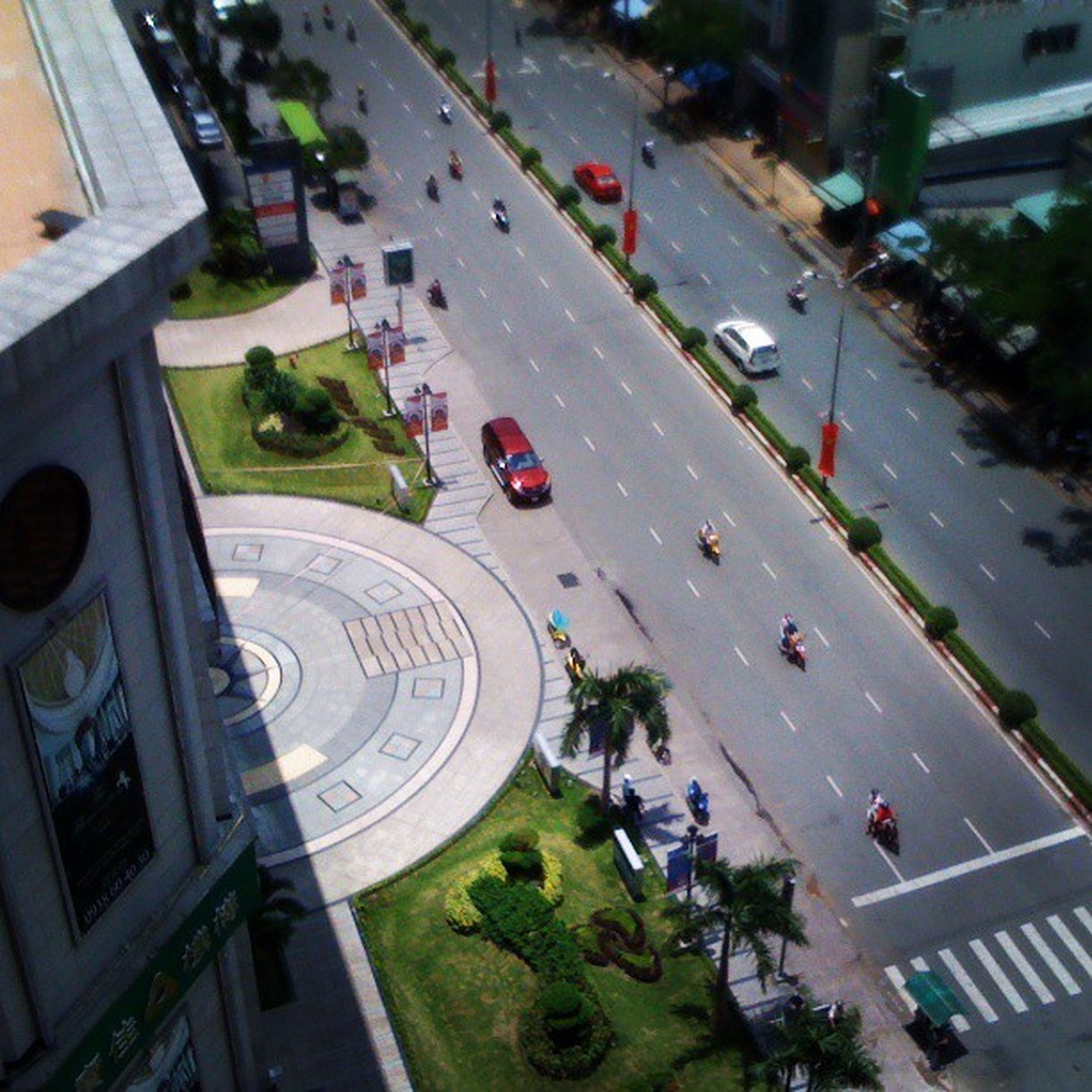 transportation, land vehicle, car, mode of transport, street, high angle view, city, road, city life, architecture, city street, large group of people, building exterior, built structure, road marking, travel, traffic, incidental people, tree