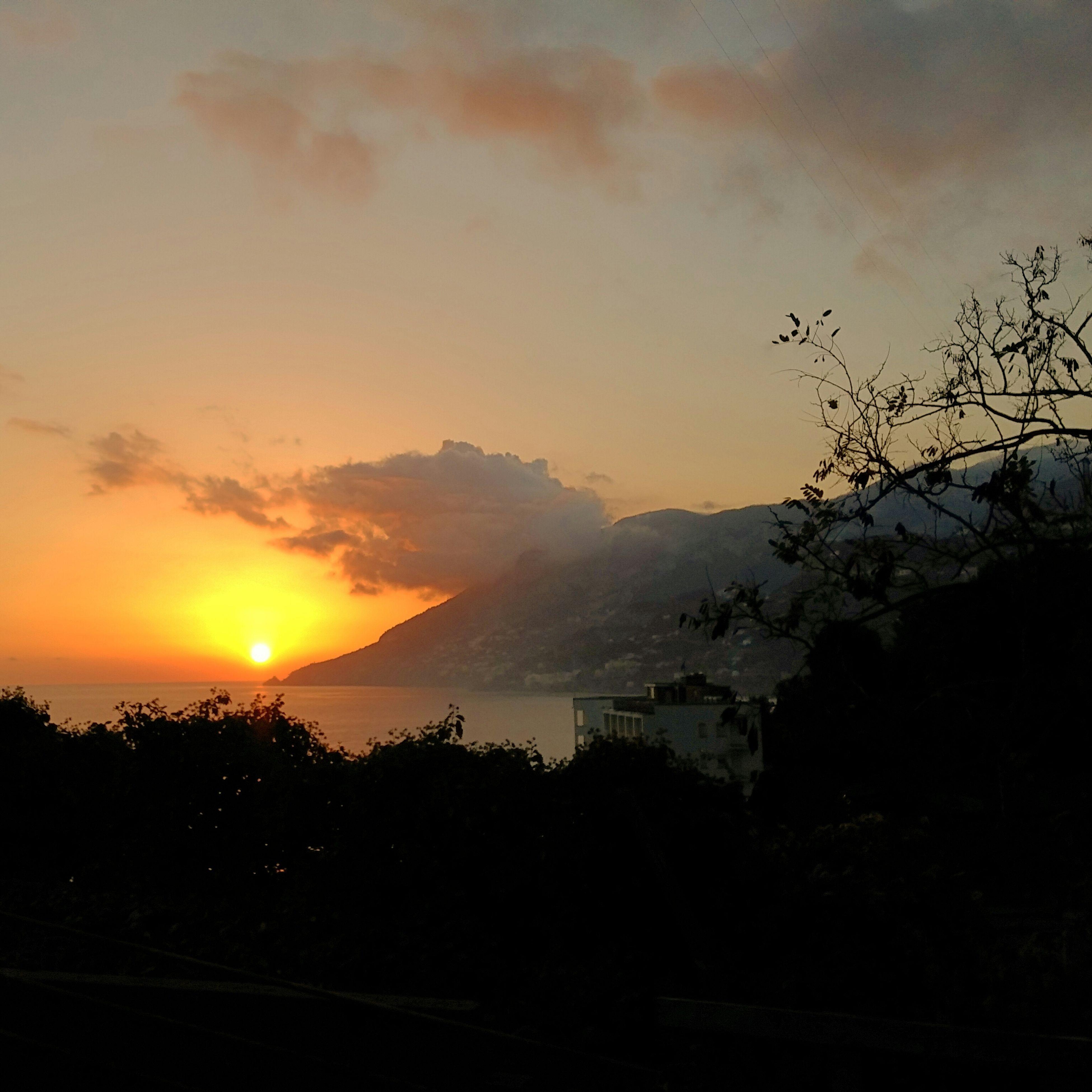 sunset, scenics, silhouette, beauty in nature, sky, tranquil scene, sun, mountain, tranquility, orange color, nature, landscape, idyllic, cloud - sky, sunlight, tree, mountain range, outdoors, non-urban scene, no people
