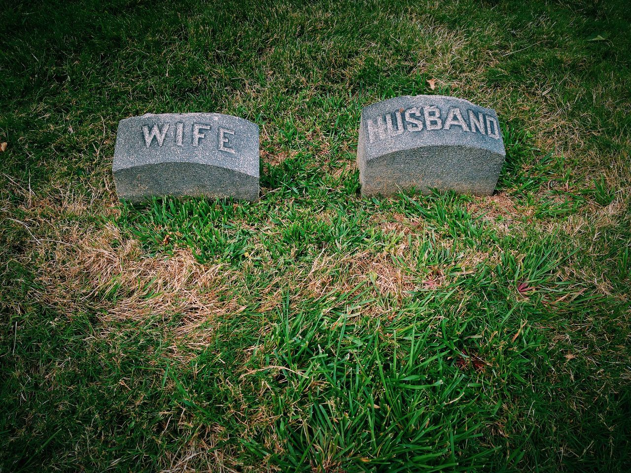 Close-Up Of Husband And Wife Tombstones