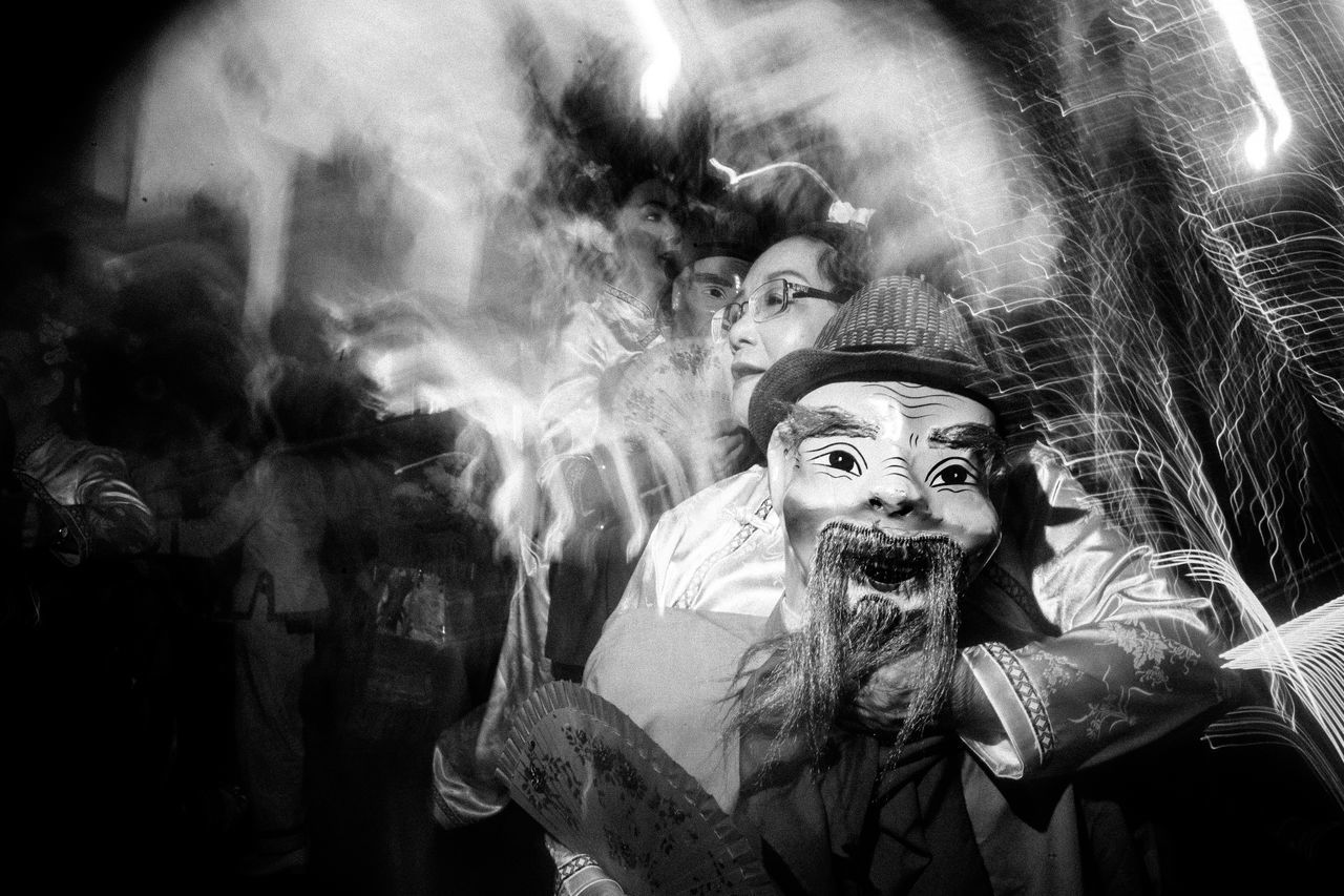 Chinatown, Singapore. 2017 © Chit Min Maung http://www.cmmaung.me/ The Chingay parade, the annual largest street performance and float parade in Asia, appeared in Chinatown, Singapore this year to bring thee celebrations to a great height but also marking the end of the Chinese New Year Celebrations. Adult Chinatown Chinese New Year Chingay2017 Cmmaung Cmmaungme Doll Flash Photography Night People Real People Singapore Slow Shutter Spooky Street Photography Streetphoto_bw The Street Photographer - 2017 EyeEm Awards