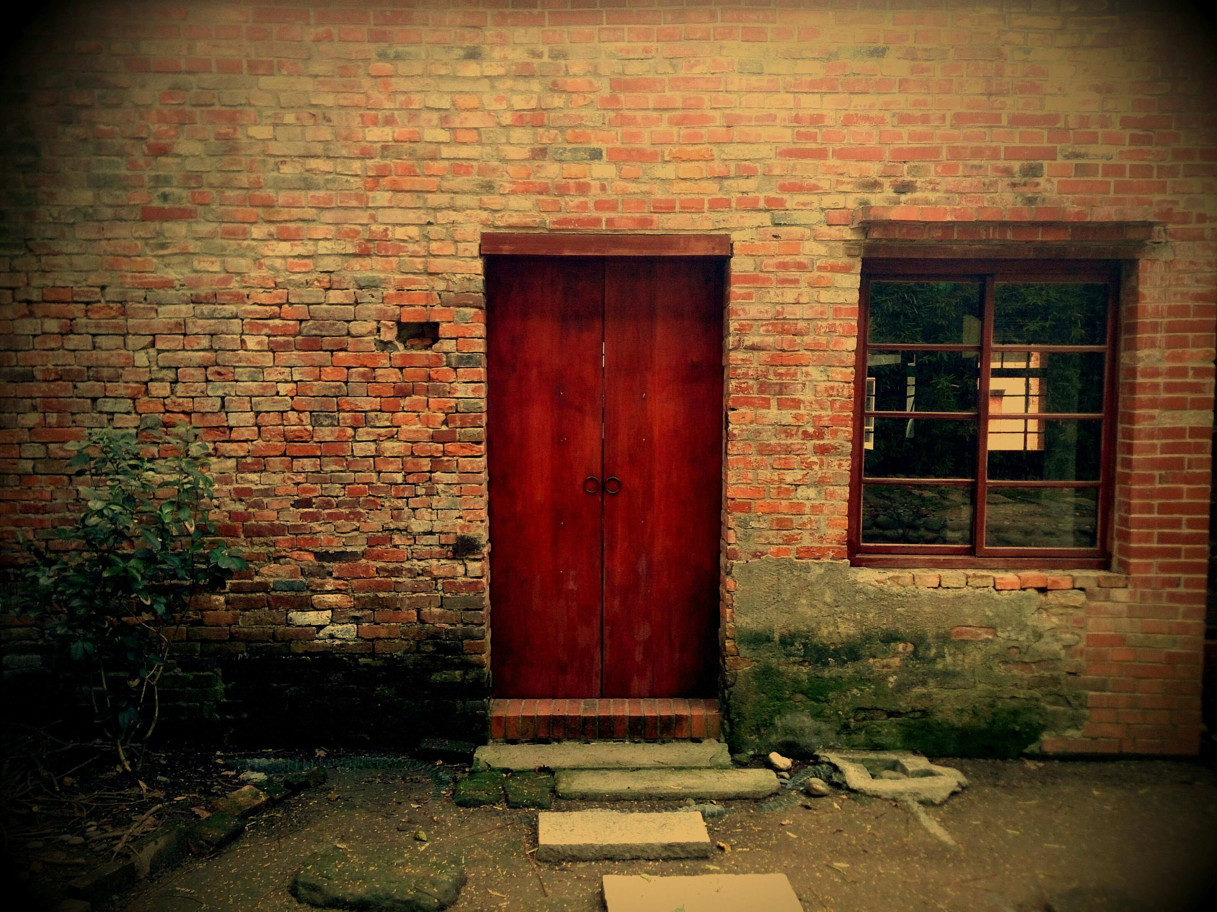 architecture, built structure, building exterior, door, closed, brick wall, house, old, wall - building feature, window, entrance, abandoned, stone wall, wall, weathered, outdoors, day, no people, safety, damaged